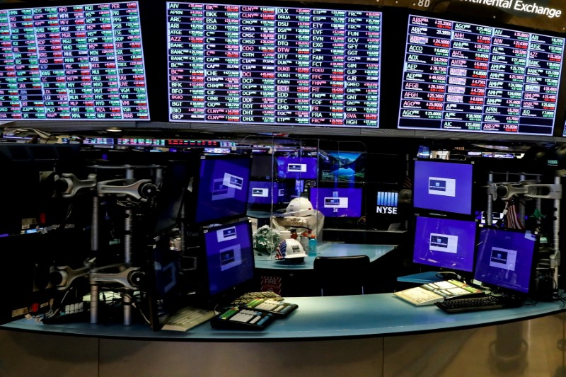 Dividers are seen inside a trading post on the trading floor as preparations are made for the return to trading at the New York Stock Exchange (NYSE), May 22, 2020. REUTERS/Brendan McDermid