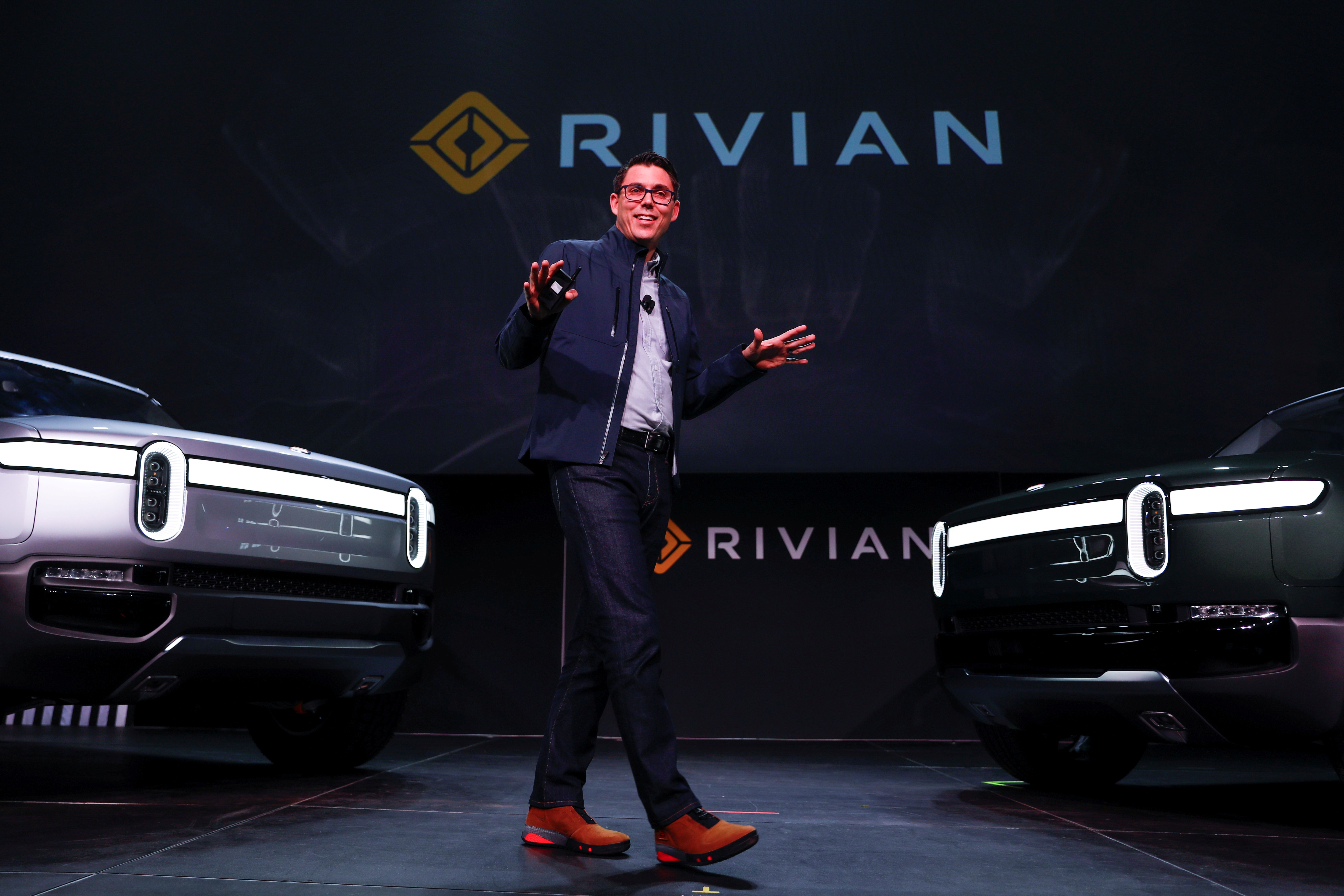 R.J. Scaringe, Rivian's 35-year-old CEO, introduces the world to his company's  R1T all-electric pickup and all-electric R1S SUV at the Los Angeles Auto Show in Los Angeles, California, U.S. November 27, 2018. REUTERS/Mike Blake