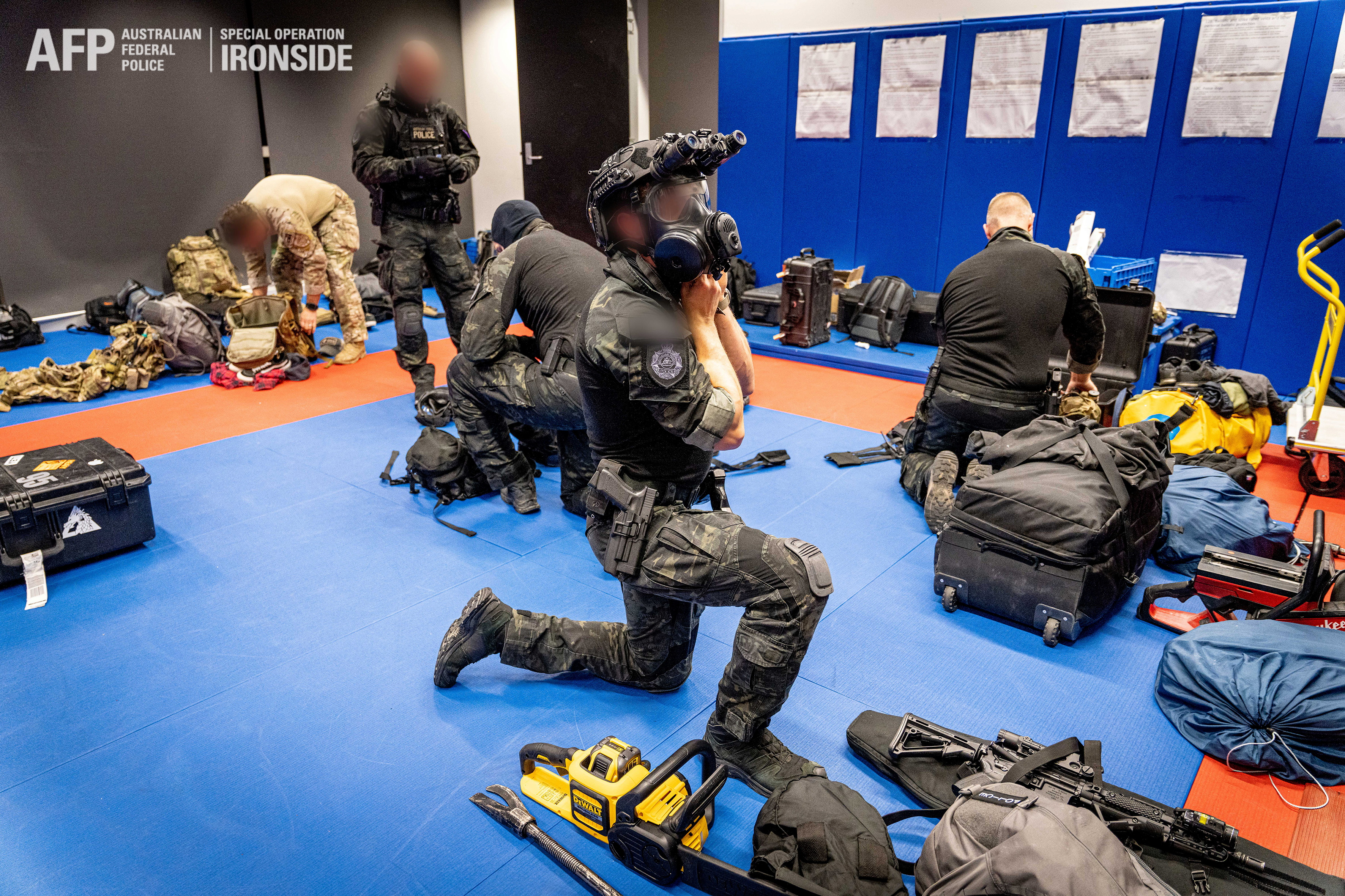 Australian Federal Police are seen during its Operation Ironside against organised crime in this undated handout photo released June 8, 2021.   Australian Federal Police/Handout via REUTERS