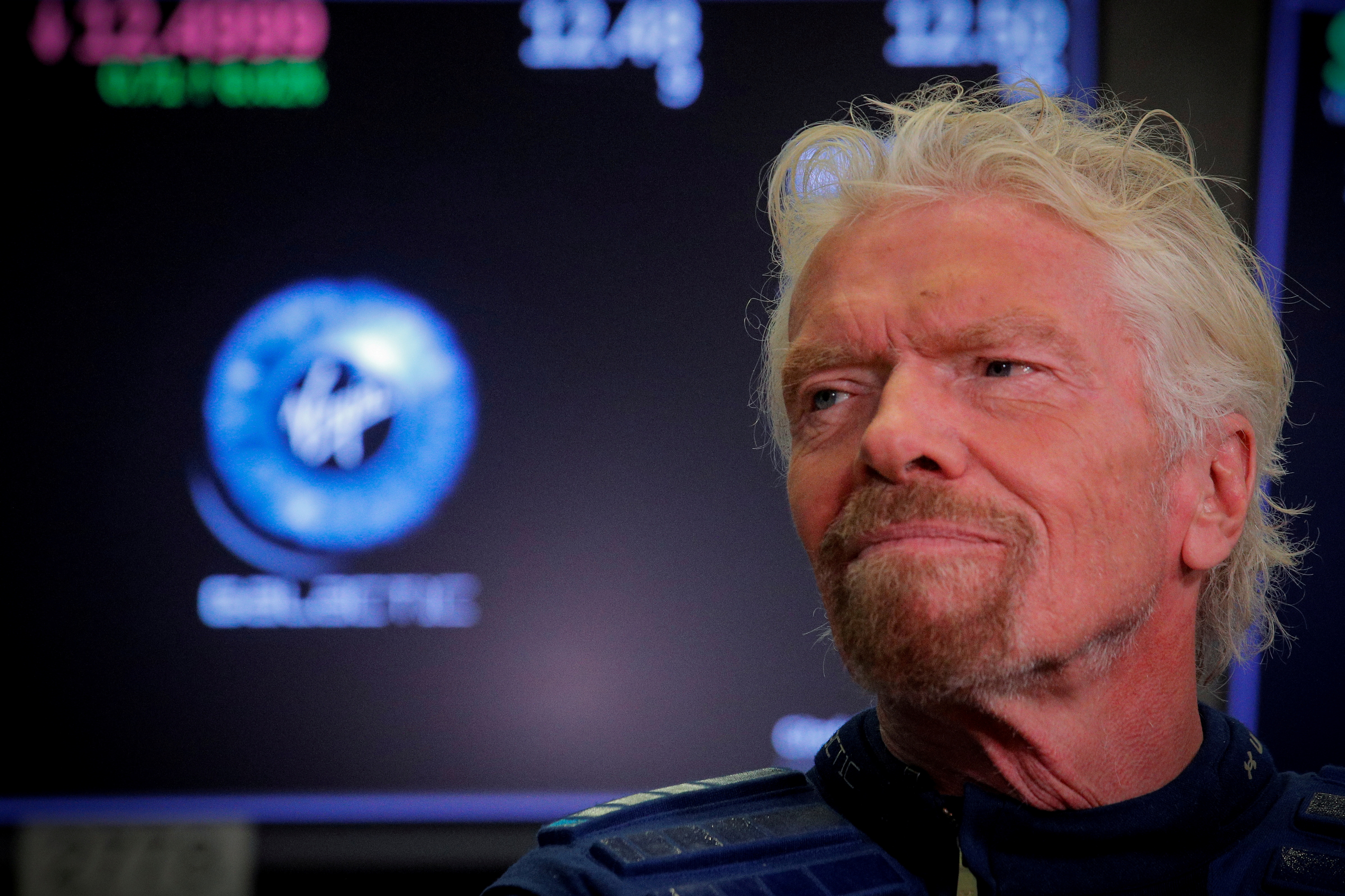 Sir Richard Branson stands on the floor of the New York Stock Exchange (NYSE) ahead of Virgin Galactic (SPCE) trading in New York, U.S., October 28, 2019. REUTERS/Brendan McDermid