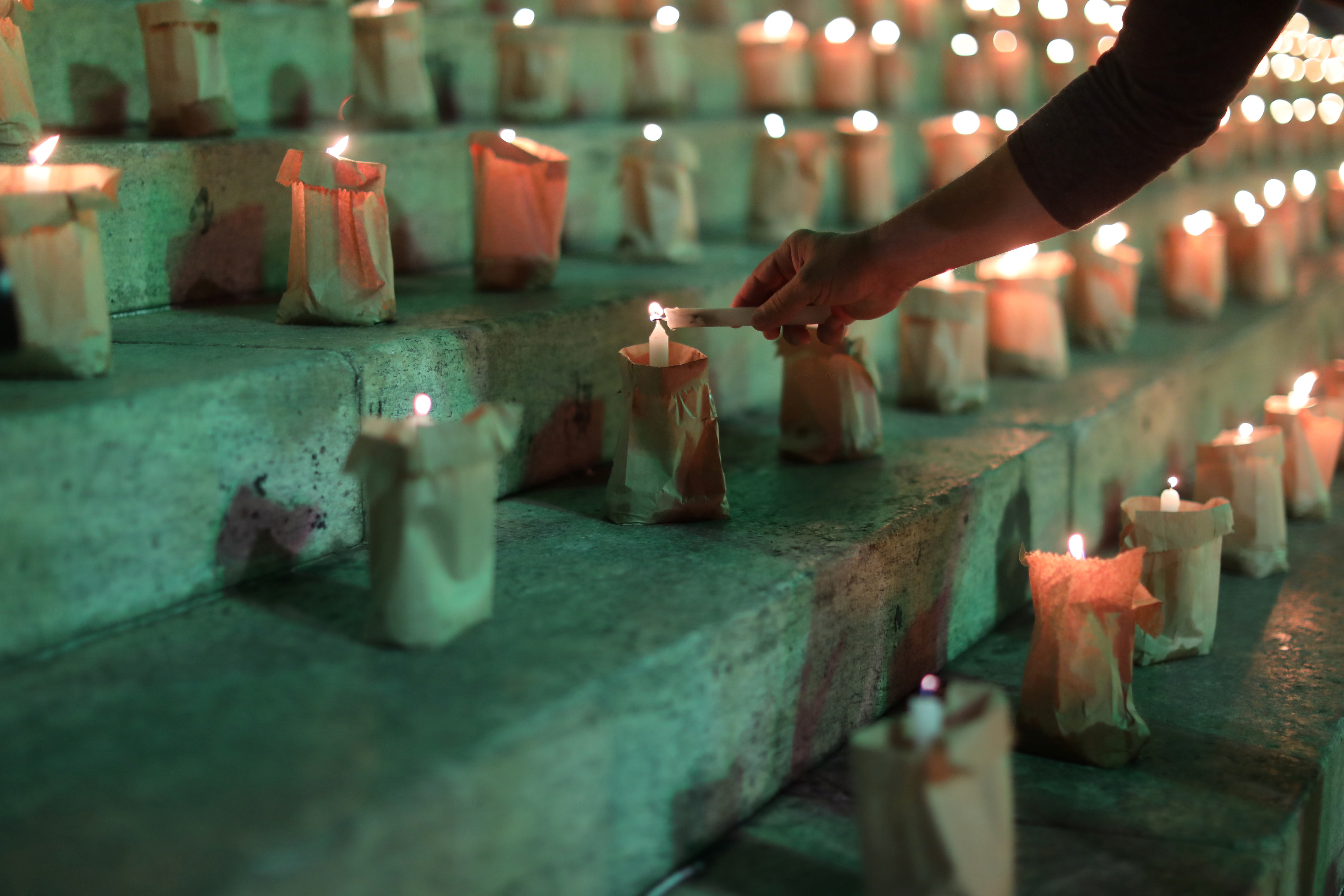 A person takes part in an event to light candles in honour of the 500,000 people who have died from the coronavirus disease (COVID-19) in Brazil, in Rio de Janeiro, Brazil, June 21, 2021. REUTERS/Pilar Olivares