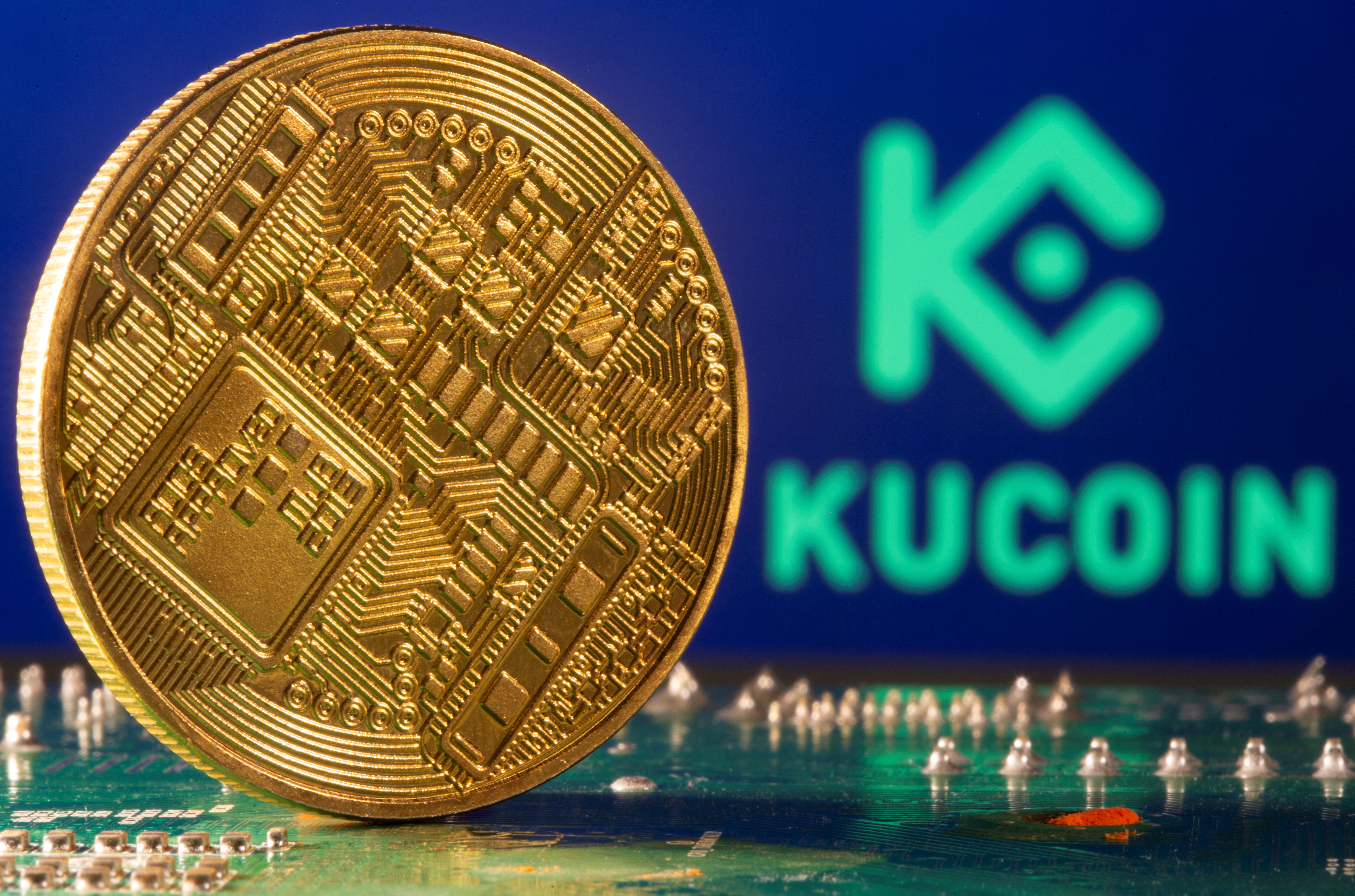 Representation of cryptocurrency is seen in front of a Kucoin logo in this illustration taken on February 9, 2021. REUTERS/Dado Ruvic/Illustration