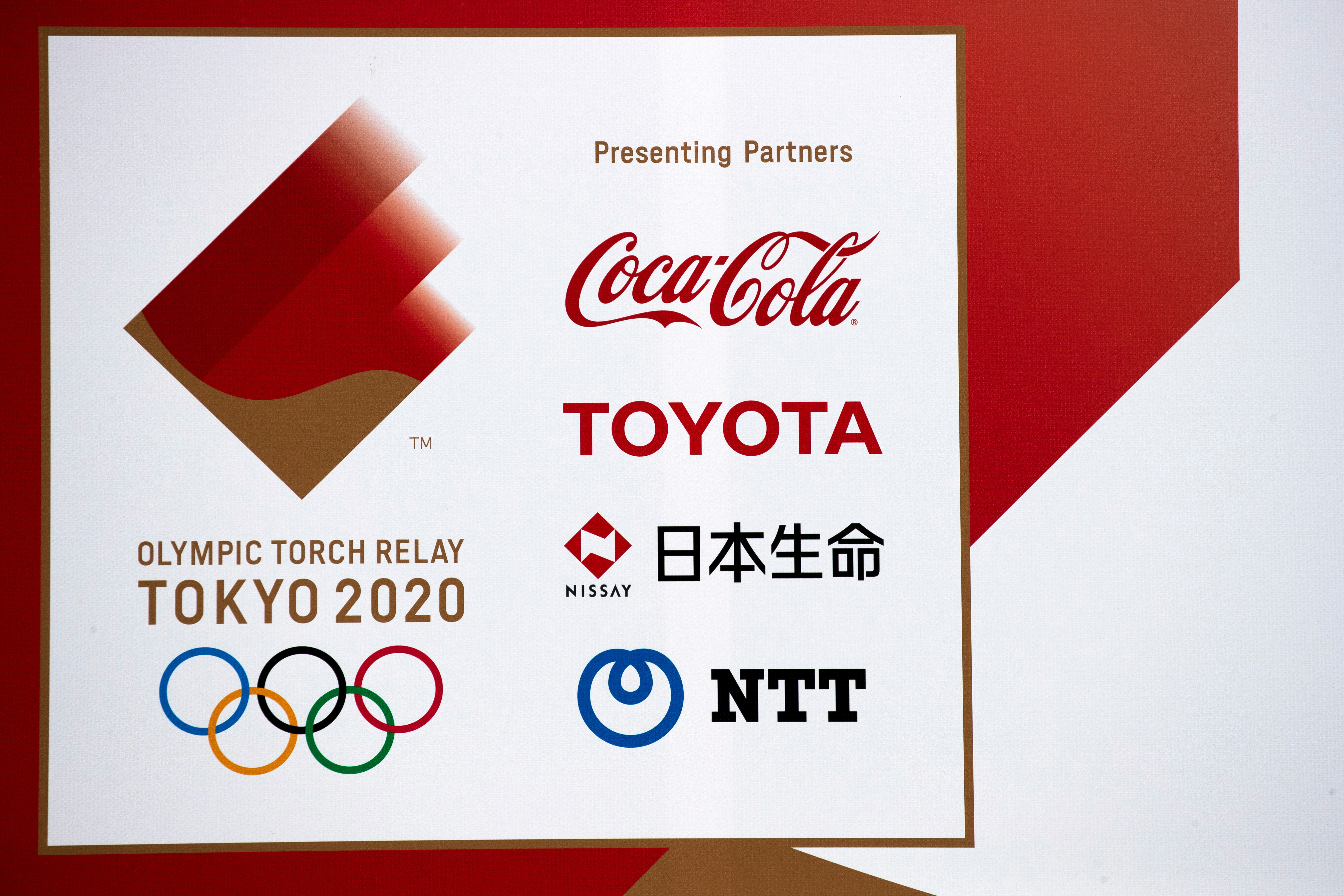 A banner advertising Coca-Cola beverages, Toyota, Nissay and NTT, Olympic Games partner for Tokyo 2020, in Fukushima prefecture, Japan March 8, 2020. Picture taken March 8, 2020. REUTERS/Athit Perawongmetha