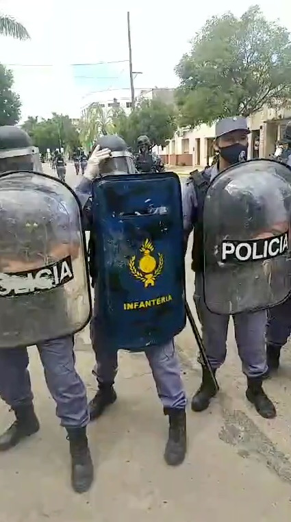 Riot police form up as people protest tightening restrictions amid a spike in COVID-19 infections, in Formosa, Argentina in this still frame obtained from social media video dated March 5, 2021. INSTAGRAM @JOVENESXLALIBERTAD /via REUTERS