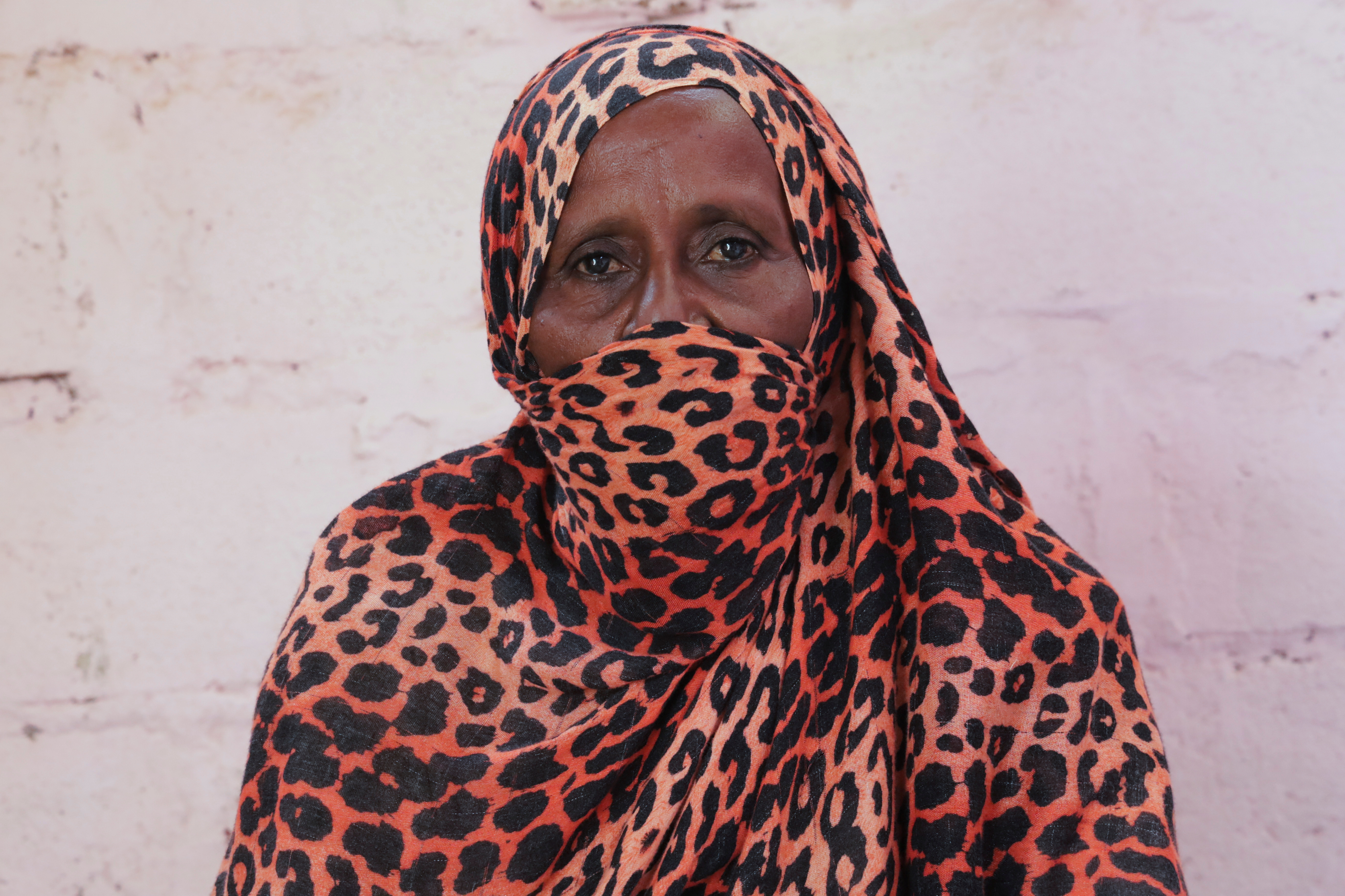 Arafa Mohammed, a Sudanese housewife who applied for Sudan's Thamarat Family Support Programme, poses for a picture in South Khartoum April 26, 2021. REUTERS/El-Tayeb Siddig