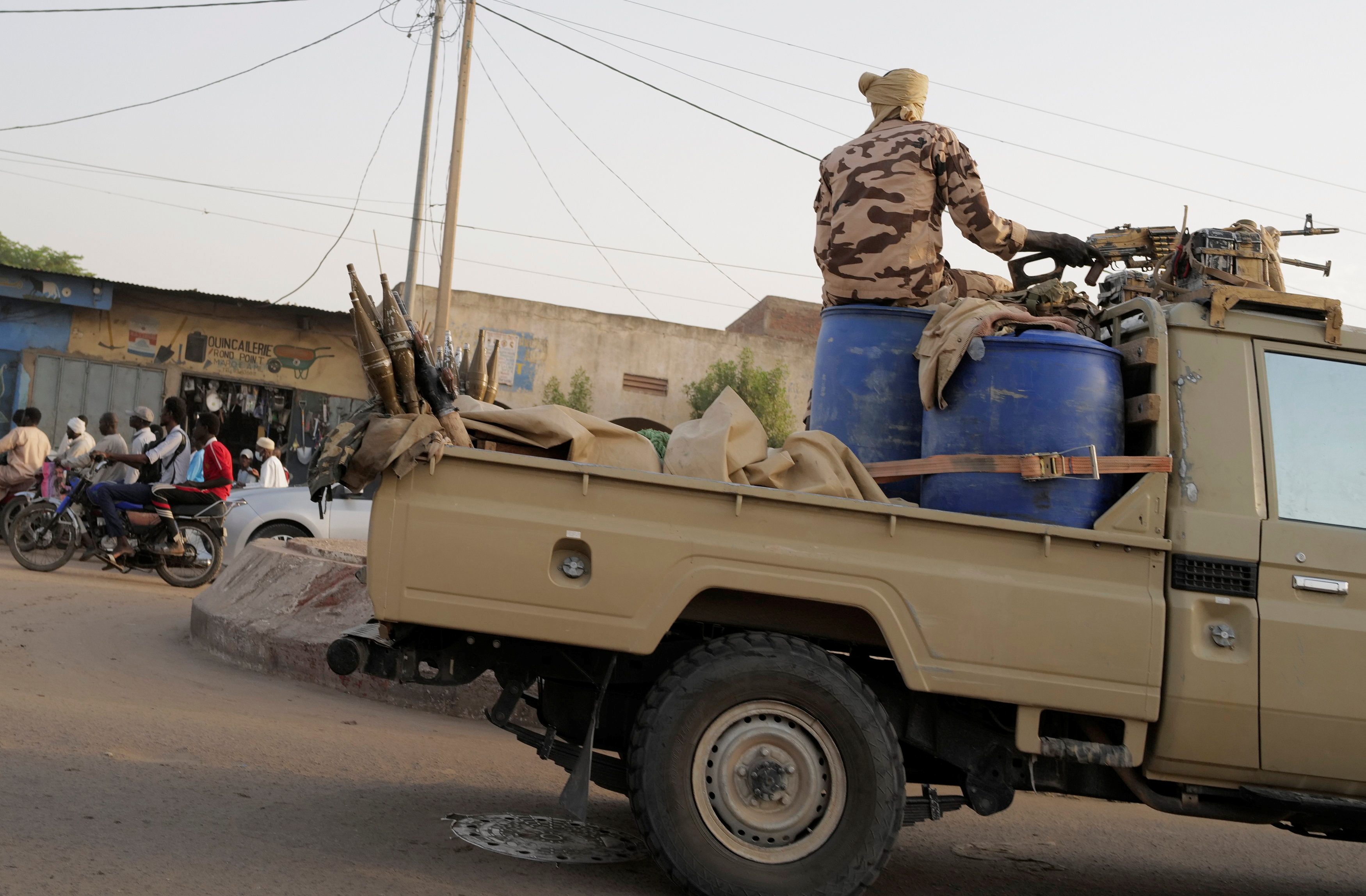 Members of the security forces drive along the market following the battlefield death of President Idriss Deby in N'Djamena, Chad April 26, 2021. REUTERS/Zohra Bensemra