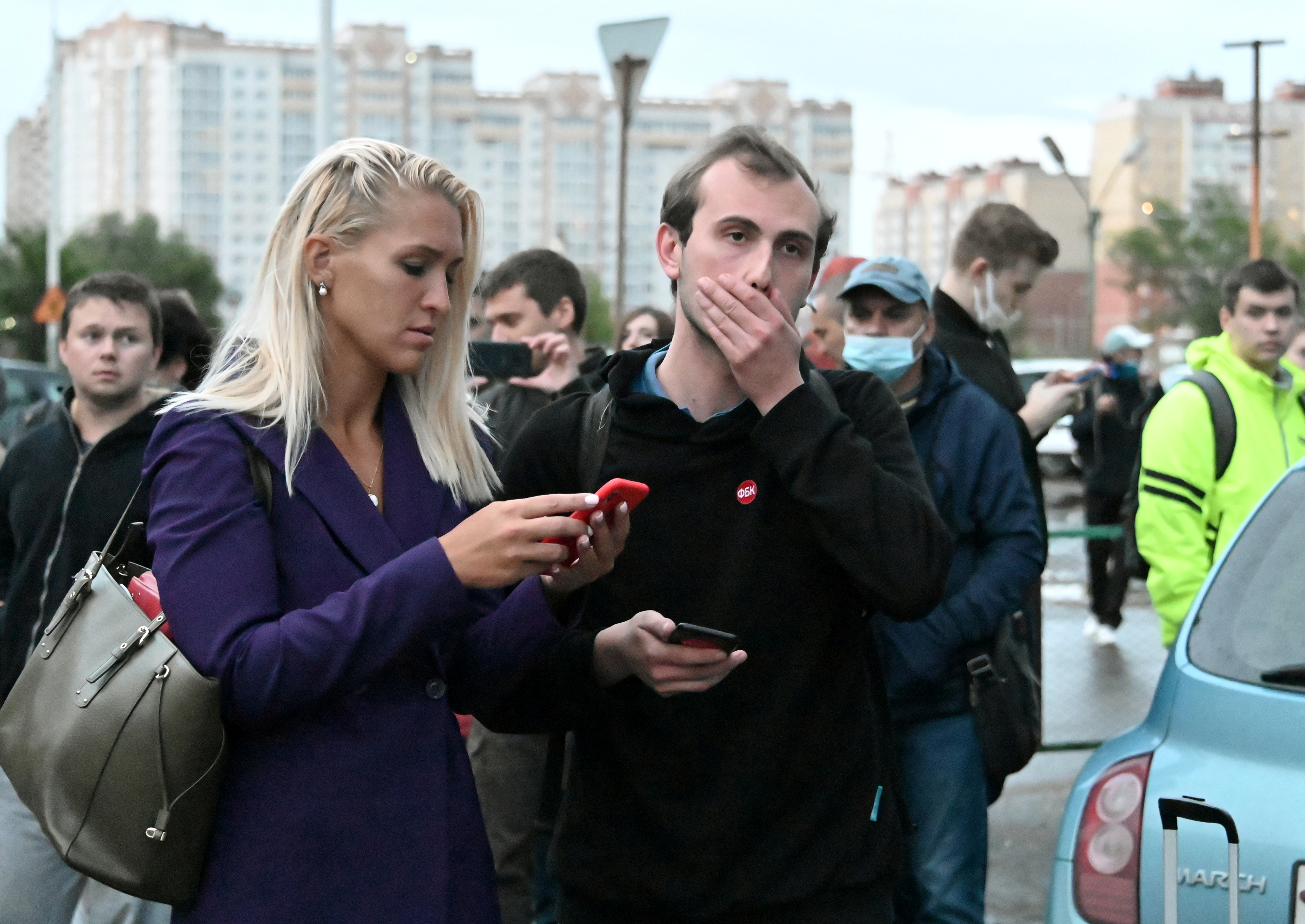 AnastasiaVasilyeva, an ally of Russian opposition politician Alexei Navalny, is seen beside Ilya Pahomov, a project manager atAnti-CorruptionFoundation, as they leave the City Clinical Emergency Hospital Number 1 where Alexei Navalny was admitted after suffering severe symptoms of what his spokeswoman called poisoning, in Omsk, Russia August 20, 2020. REUTERS/Alexey Malgavko/File Photo