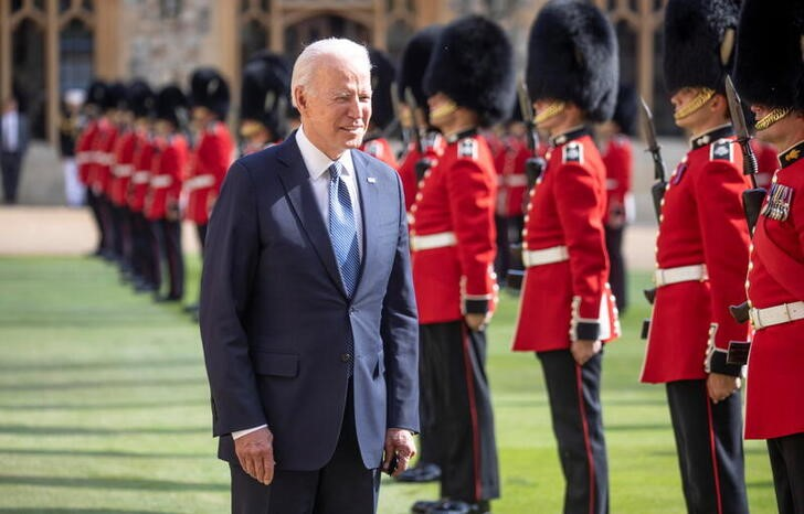 U.S. President Joe Biden inspects a Guard of Honour after arriving to meet Britain's Queen Elizabeth at Windsor Castle, in Windsor, Britain, June 13, 2021. Richard Pohle/Pool via REUTERS