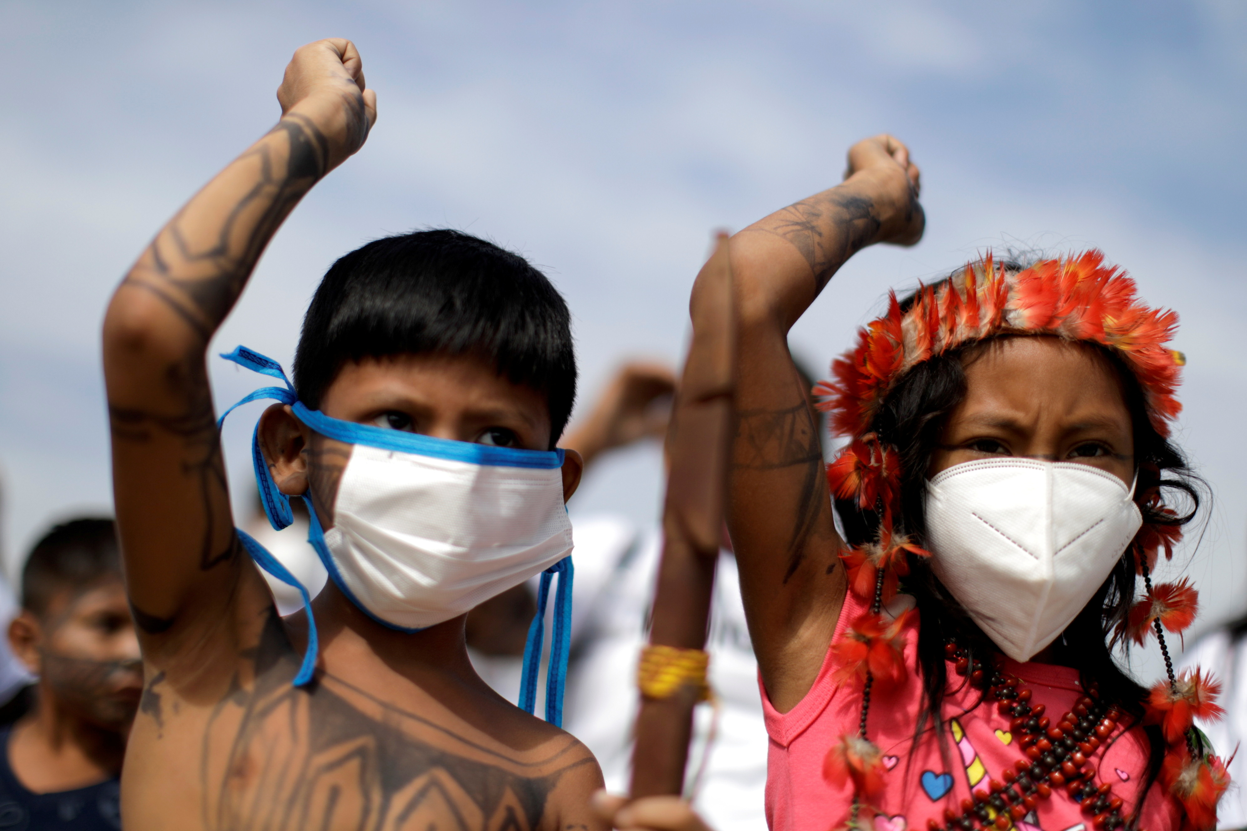 Children from the indigenous Munduruku ethnic group wearing protective face masks take part in a protest in favor of mining and against the entry of NGOs in indigenous lands in Brasilia, Brazil April 20, 2021. REUTERS/Ueslei Marcelino/File Photo