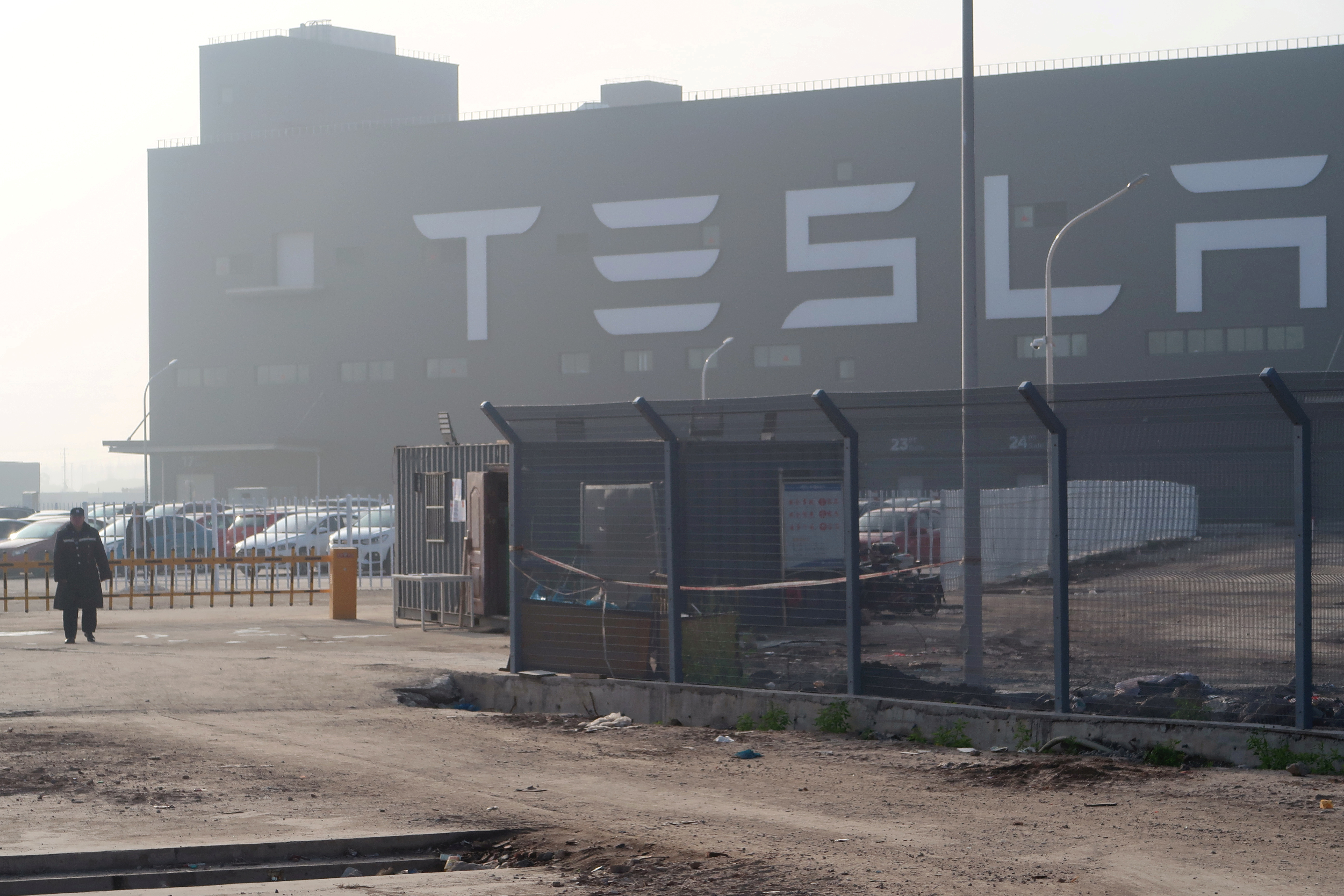 A Tesla sign is seen on the Shanghai Gigafactory of the U.S. electric car maker in Shanghai, China, Dec. 30, 2019. REUTERS/Yilei Sun/File Photo