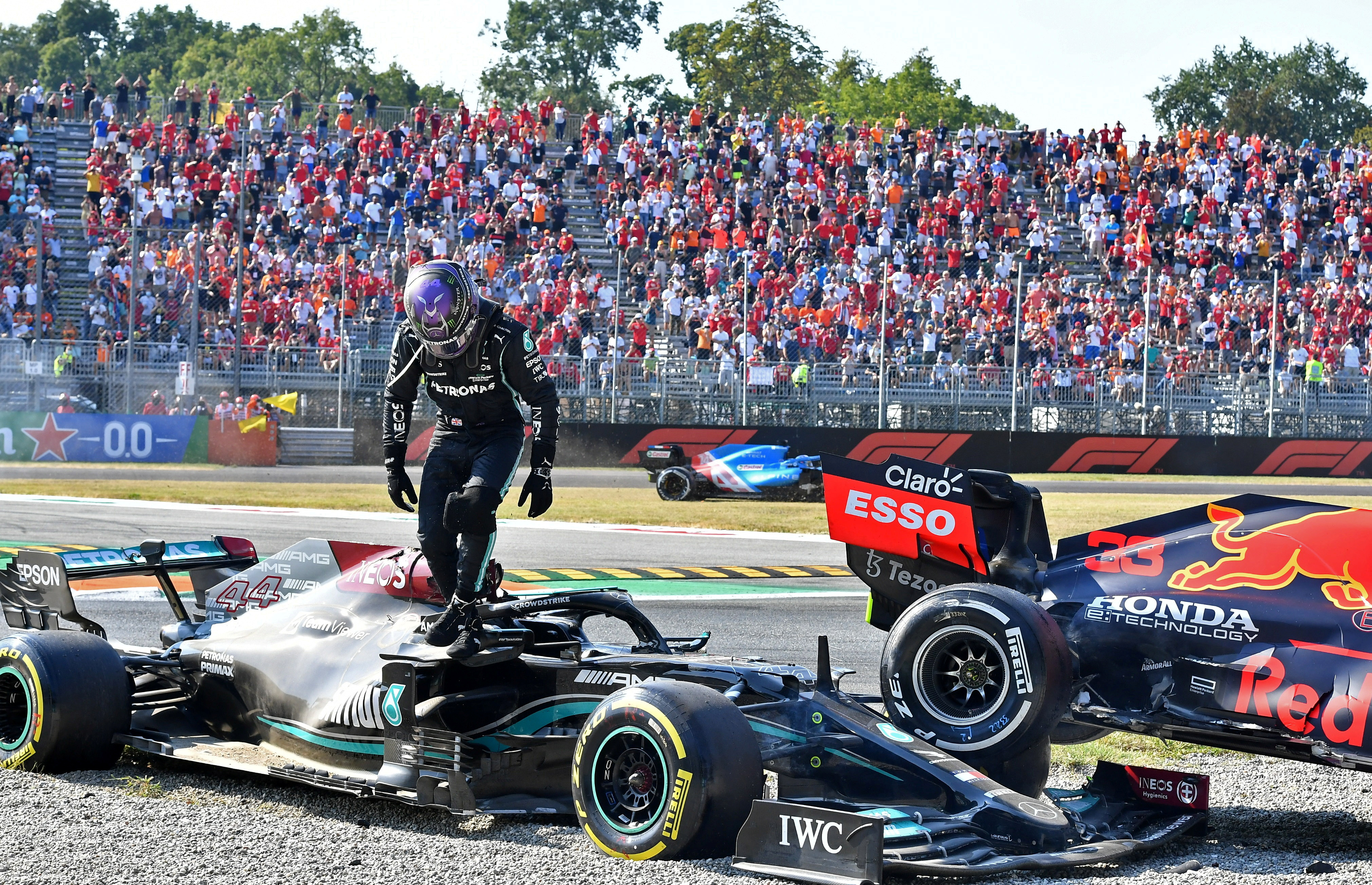 Formula One F1 - Italian Grand Prix - Autodromo Nazionale Monza, Monza, Italy - September 12, 2021 Mercedes' Lewis Hamilton after crashing out of the race with Red Bull's Max Verstappen REUTERS/Jennifer Lorenzini/File photo
