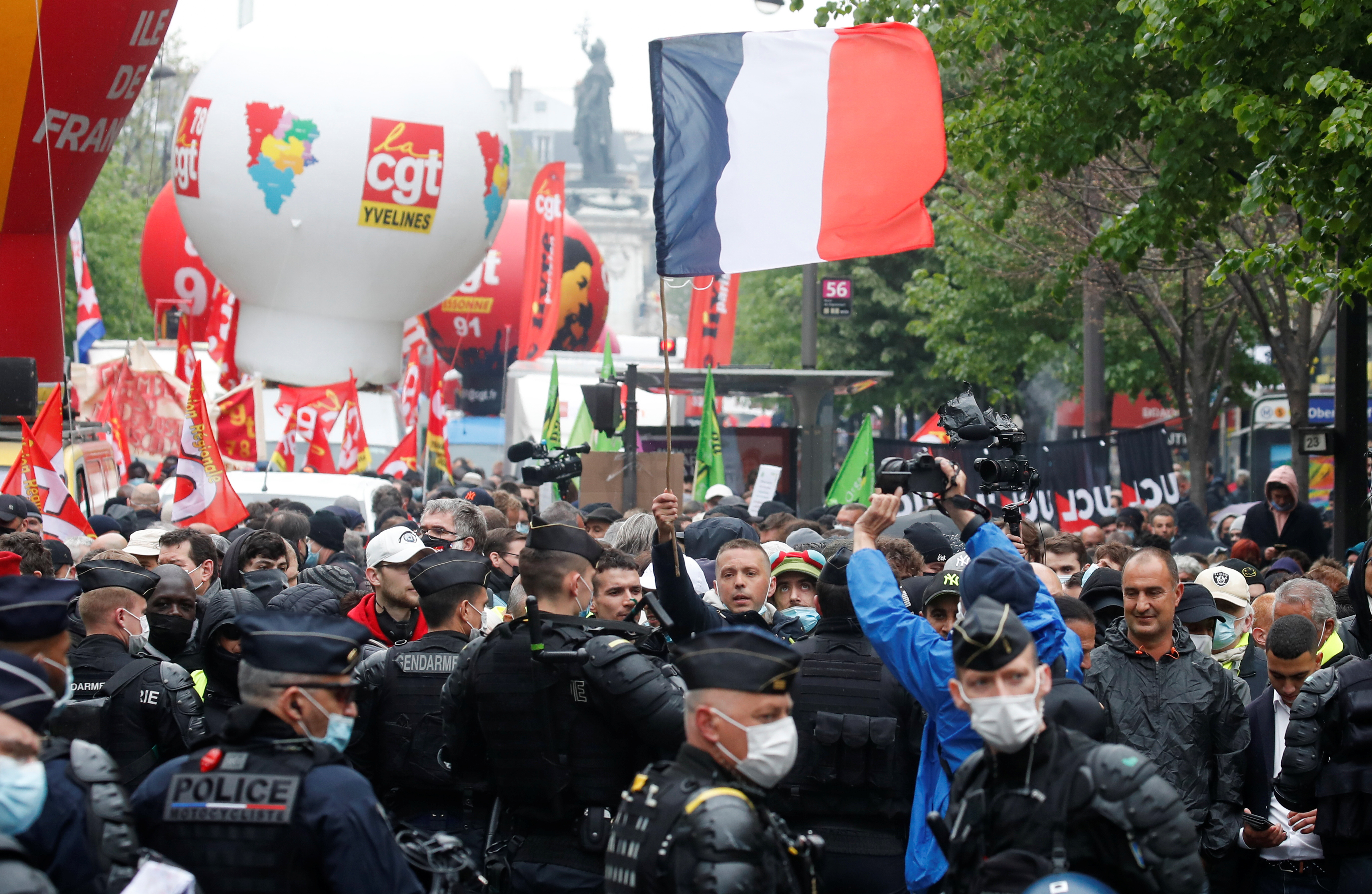 People attend the traditional May Day labour union demonstration, amid the coronavirus disease (COVID-19) outbreak in Paris, France, May 1, 2021. REUTERS/Gonzalo Fuentes