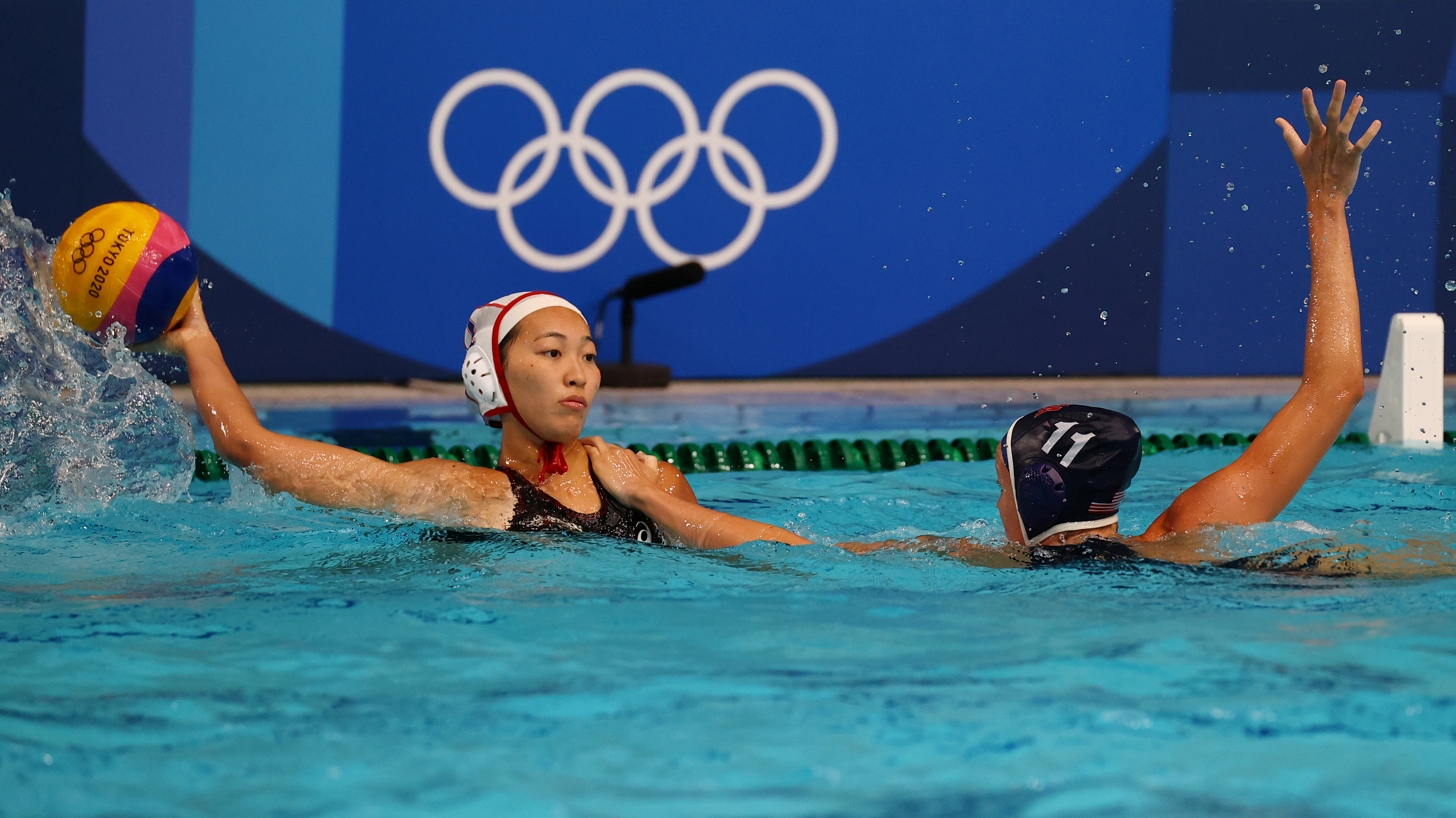Tokyo 2020 Olympics - Water Polo - Women - Group B - Japan v United States -  Tatsumi Water Polo Centre, Tokyo, Japan – July 24, 2021. Maiko Hashida of Japan and Makenzie Fischer of the United States in action. REUTERS/Kacper Pempel