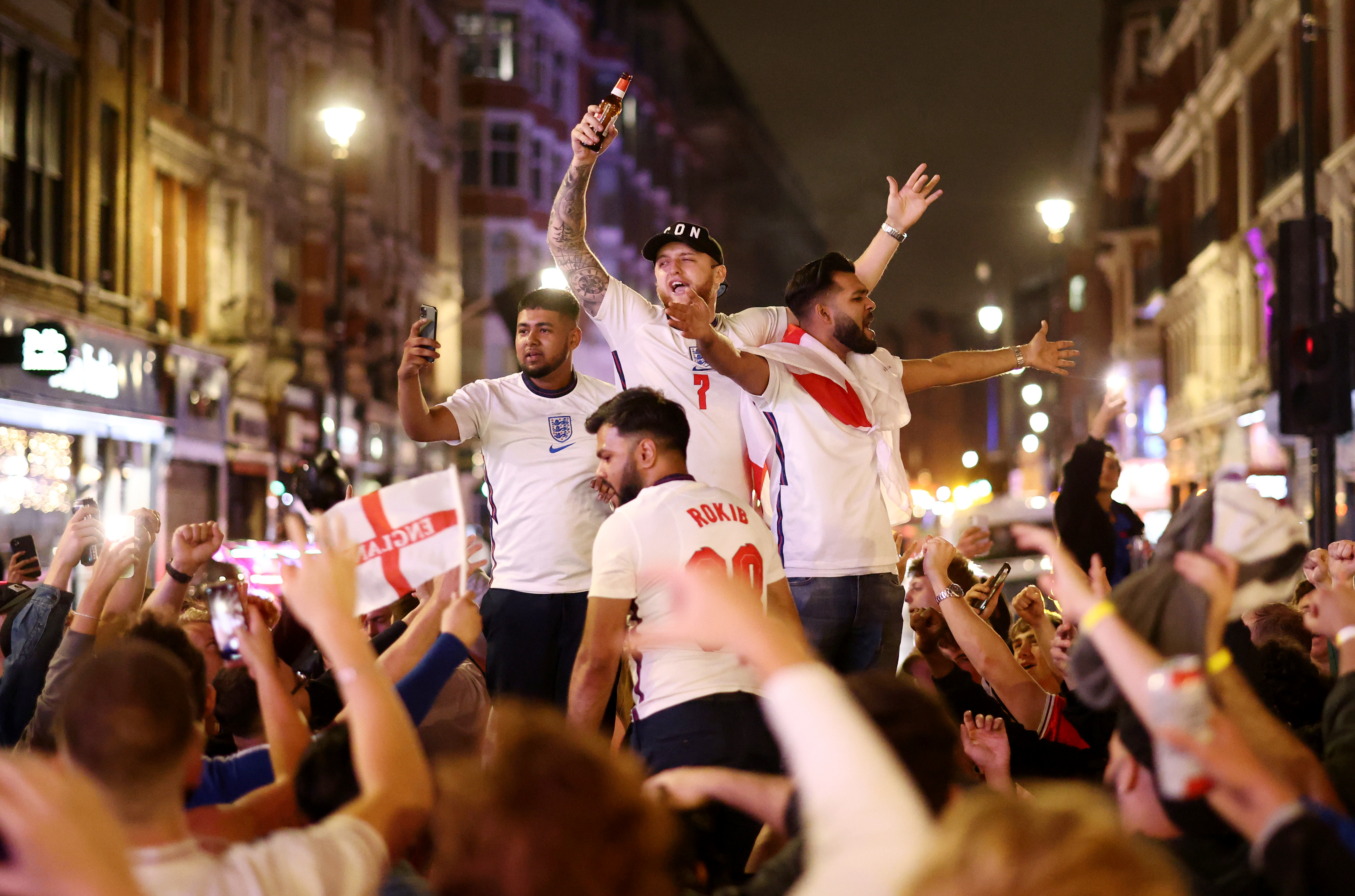 Soccer Football - Euro 2020 - Fans gather for England v Denmark - London, Britain - July 7, 2021 Fans celebrate after the match REUTERS/Henry Nicholls