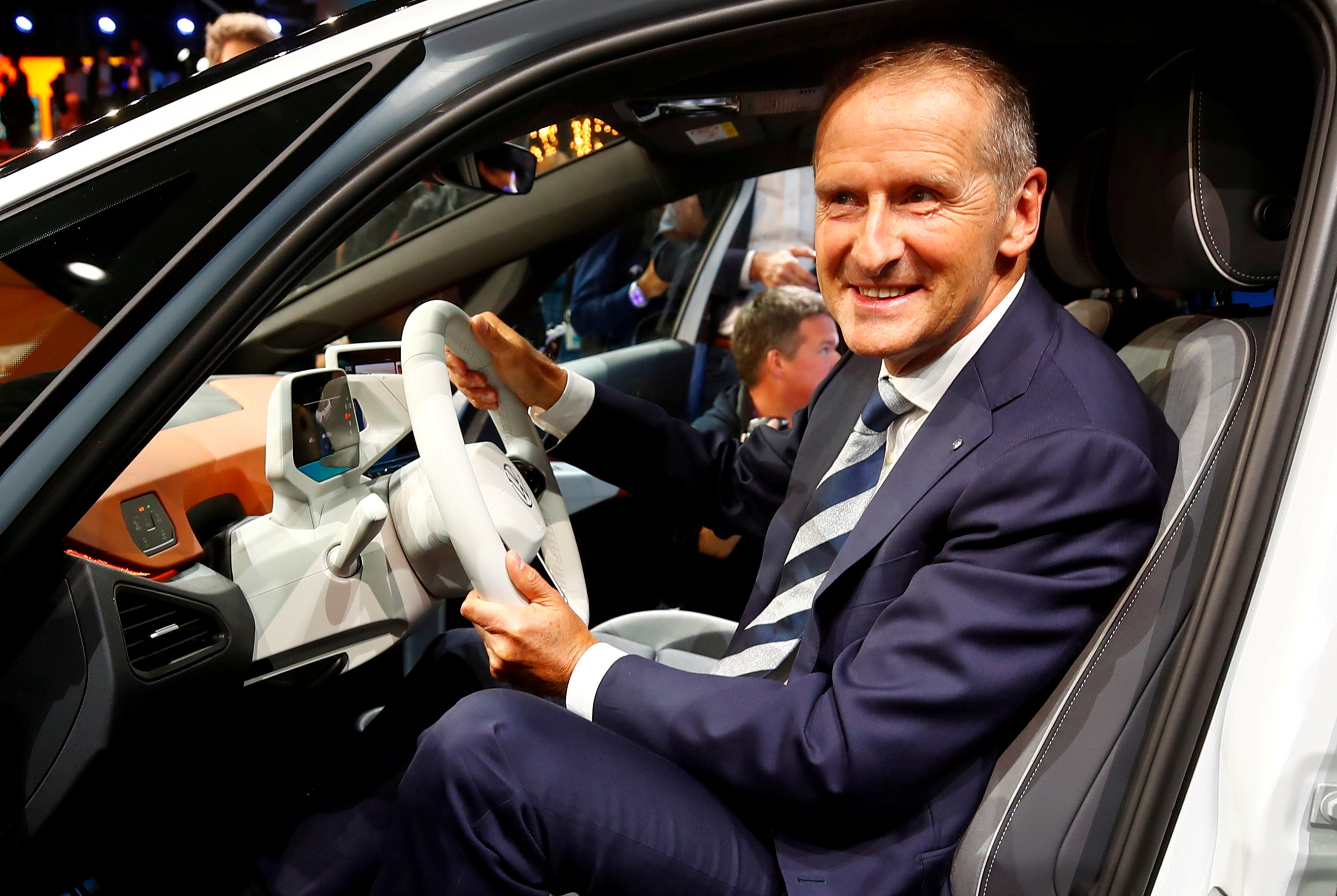 Herbert Diess, CEO of German carmaker Volkswagen AG, poses in an ID.3 pre-production prototype during the presentation of Volkswagen's new electric car on the eve of the International Frankfurt Motor Show IAA in Frankfurt, Germany September 9, 2019. REUTERS/Wolfgang Rattay/File Photo