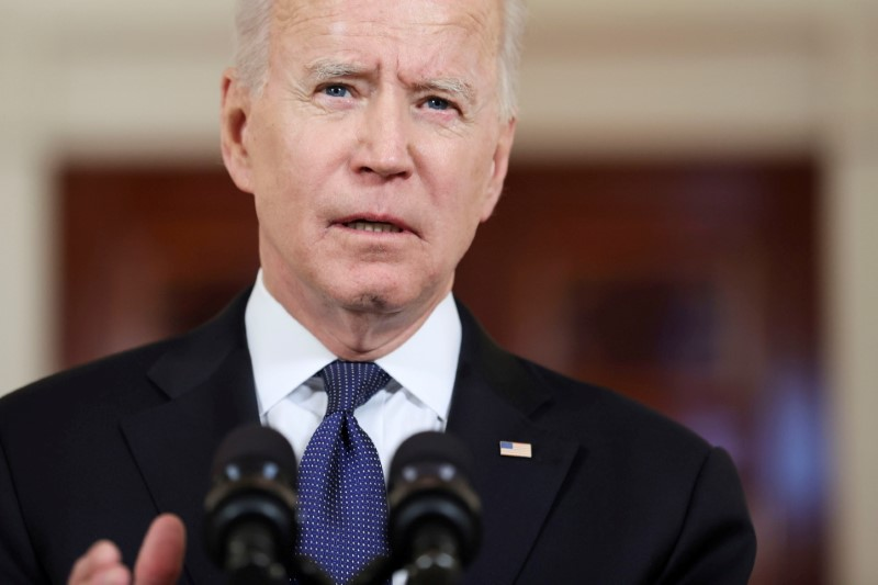 U.S. President Joe Biden delivers remarks during a brief appearance in the Cross Hall at the White House in Washington, U.S., May 20, 2021. REUTERS/Jonathan Ernst