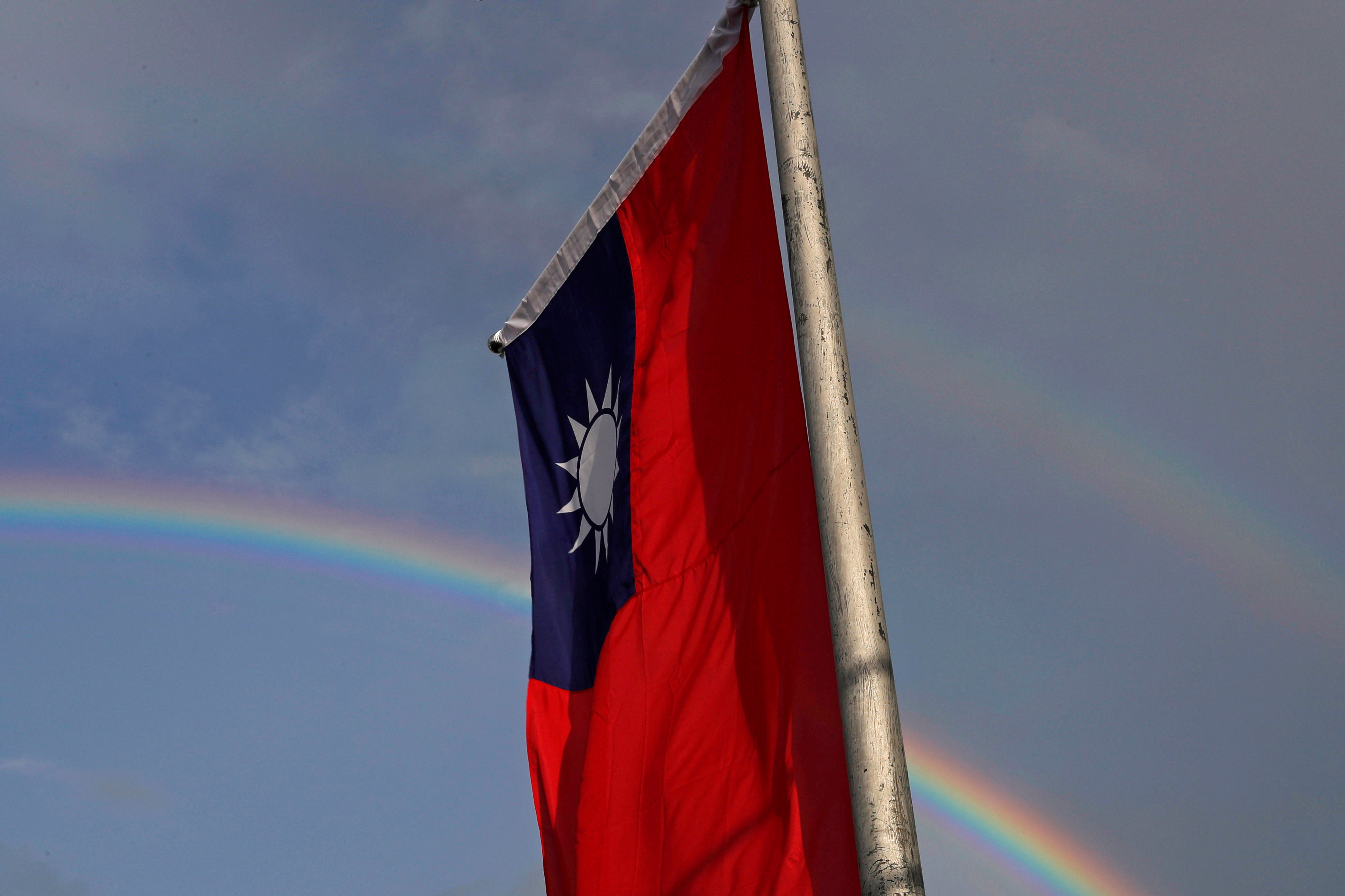 A double rainbow is seen behind Taiwanese flag during the National Day celebrations in Taipei, Taiwan, October 10, 2017. REUTERS/Tyrone Siu