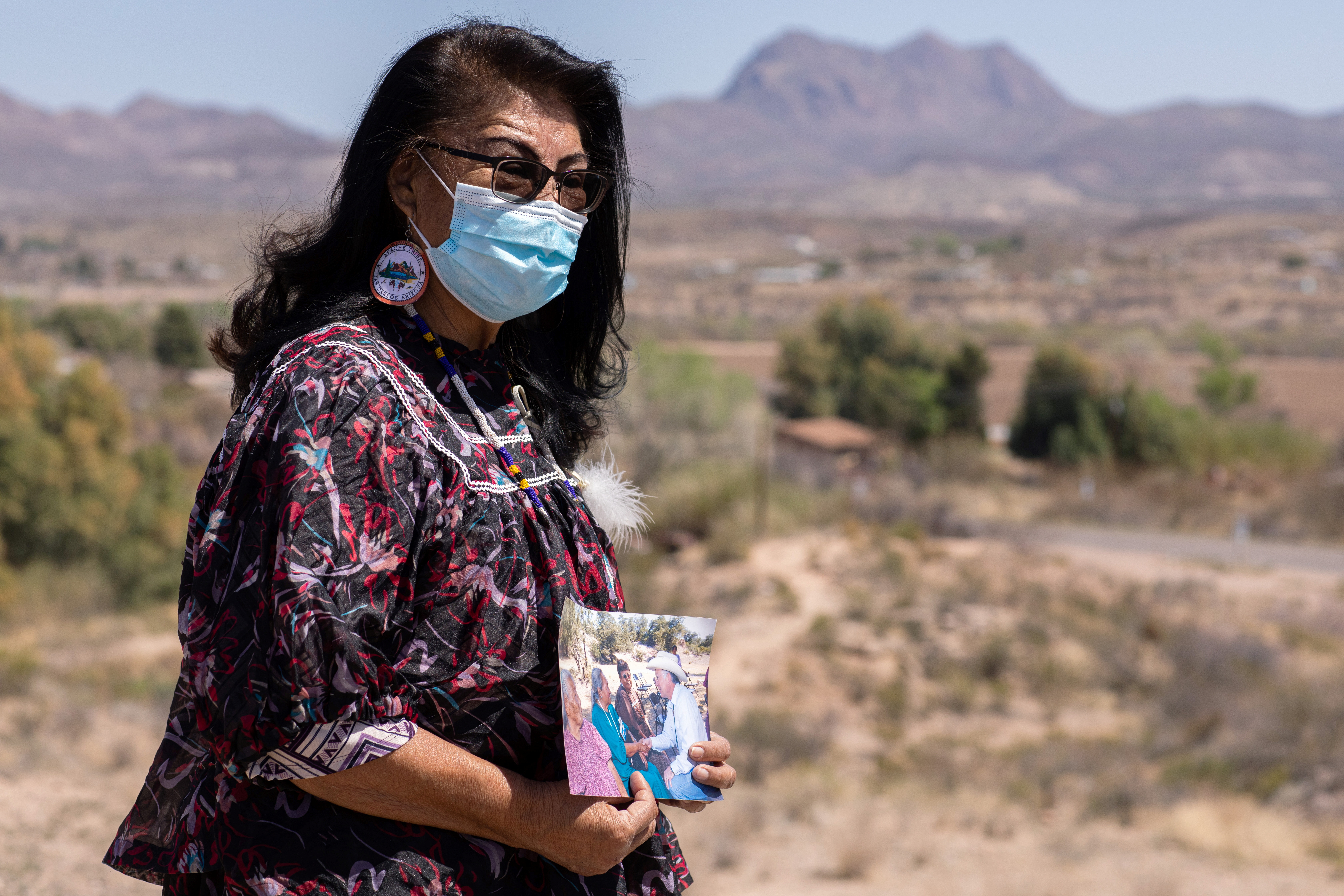 Sandra Rambler, a San Carlos Apache tribal elder, holds a photo of her mother talking with former Secretary of the Interior Ken Salazar during his visit to Oak Flat in 2009, in San Carlos, Arizona, U.S., March 31, 2021.
