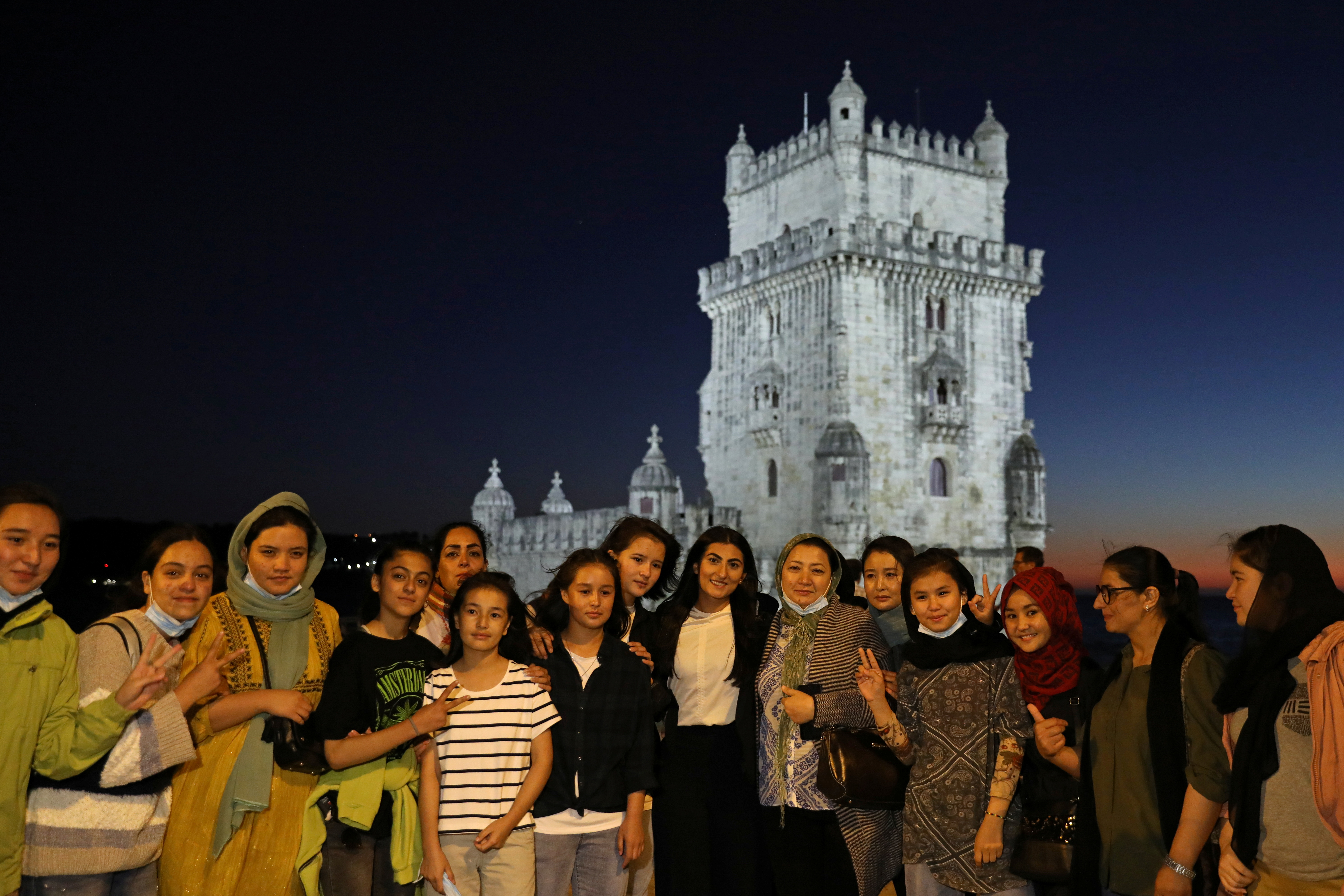 The captain of Afghanistan's national women football team Farkhunda Muhtaj (C) poses for a portrait with teammates at the Belem Tower in Lisbon, Portugal, September 29, 2021. Picture taken September 29, 2021. REUTERS/Rodrigo Antunes NO RESALES. NO ARCHIVES