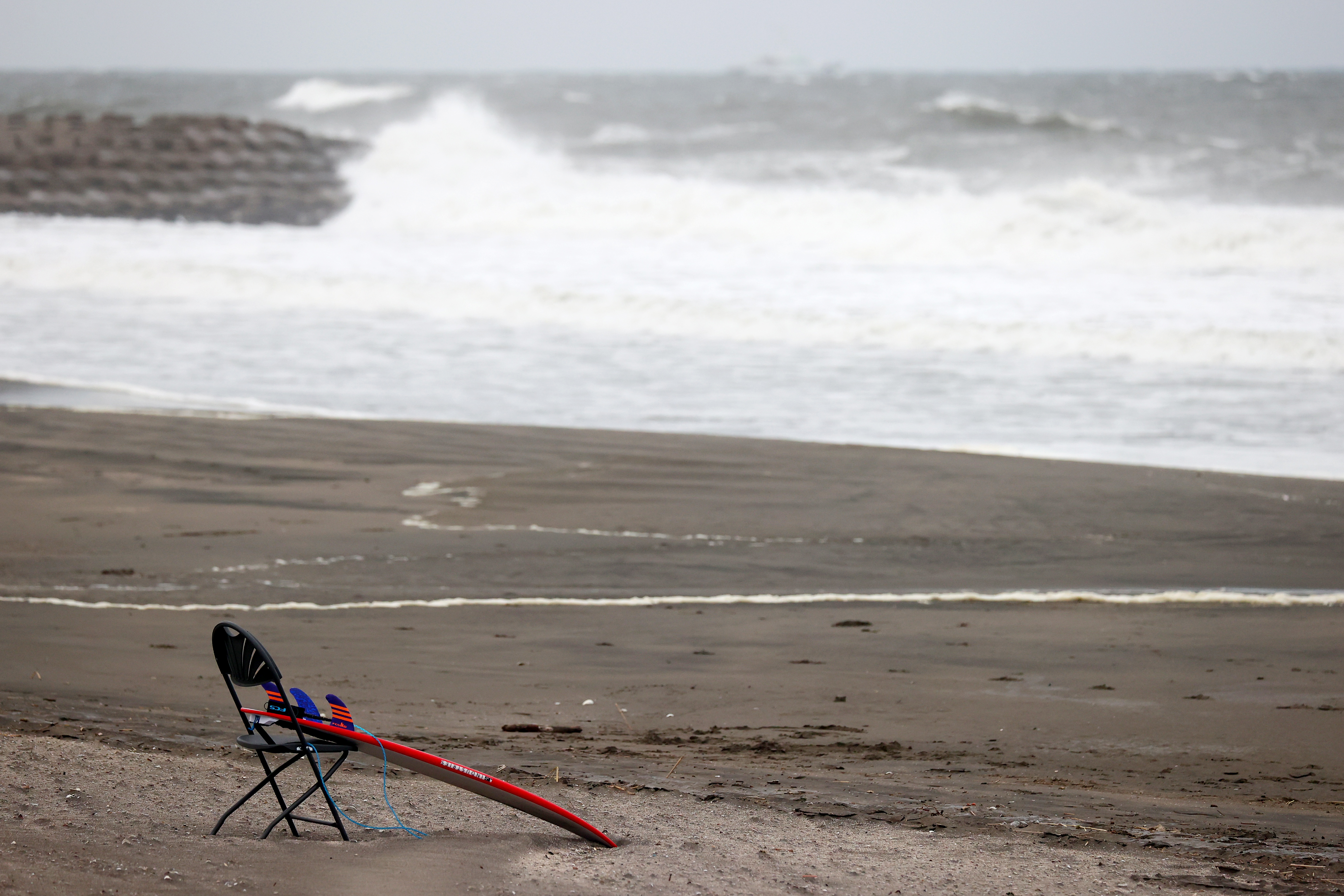 Tokyo 2020 Olympics - Surfing - Men's Shortboard - Round 3 - Tsurigasaki Surfing Beach, Tokyo, Japan - July 26, 2021. General view of a surfboard leant on a chair REUTERS/Lisi Niesner