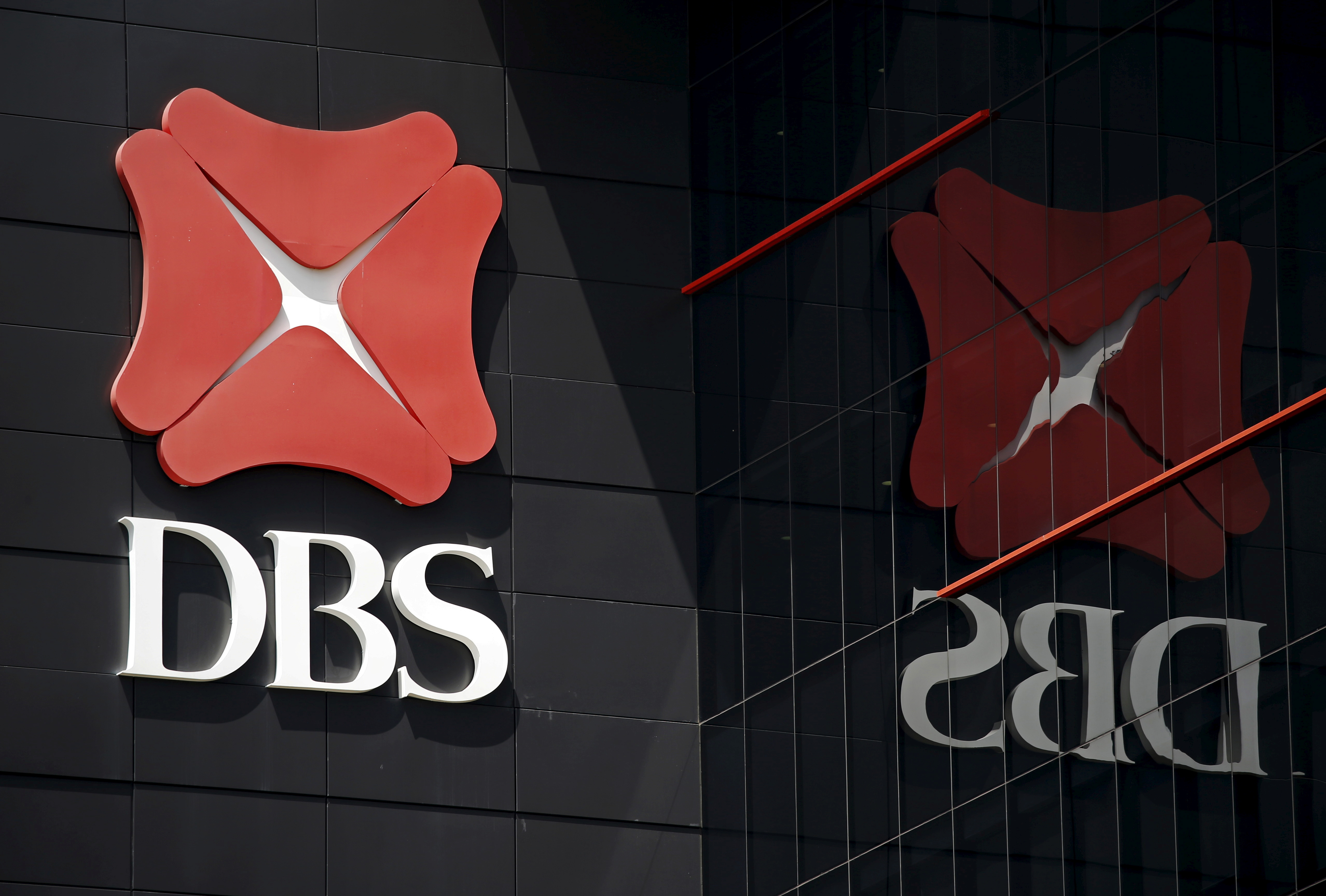 A logo of DBS is pictured outside an office in Singapore January 5, 2016.  REUTERS/Edgar Su/File Photo  GLOBAL BUSINESS WEEK AHEAD