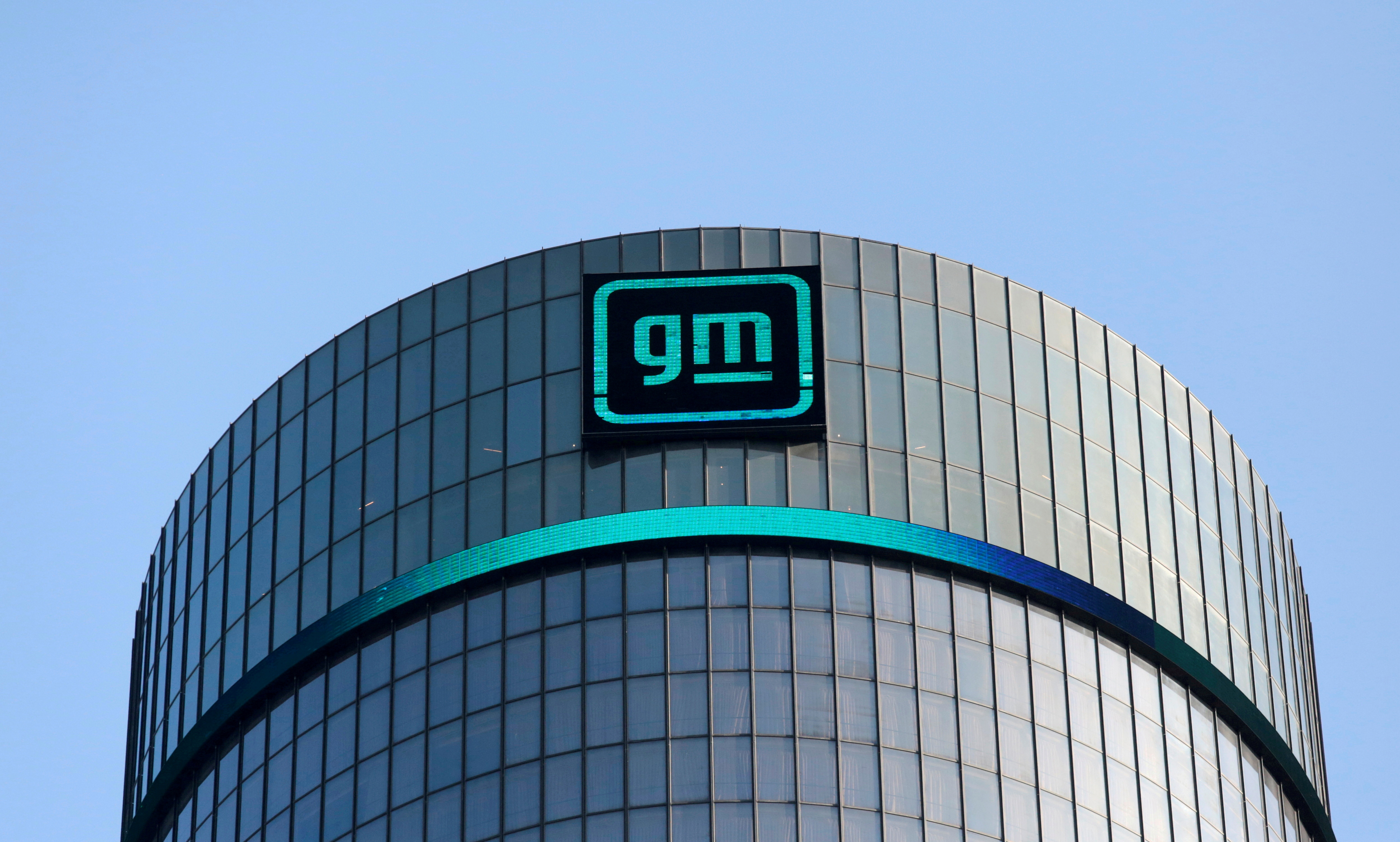The new GM logo is seen on the facade of the General Motors headquarters in Detroit, Michigan, U.S., March 16, 2021. REUTERS/Rebecca Cook//File Photo