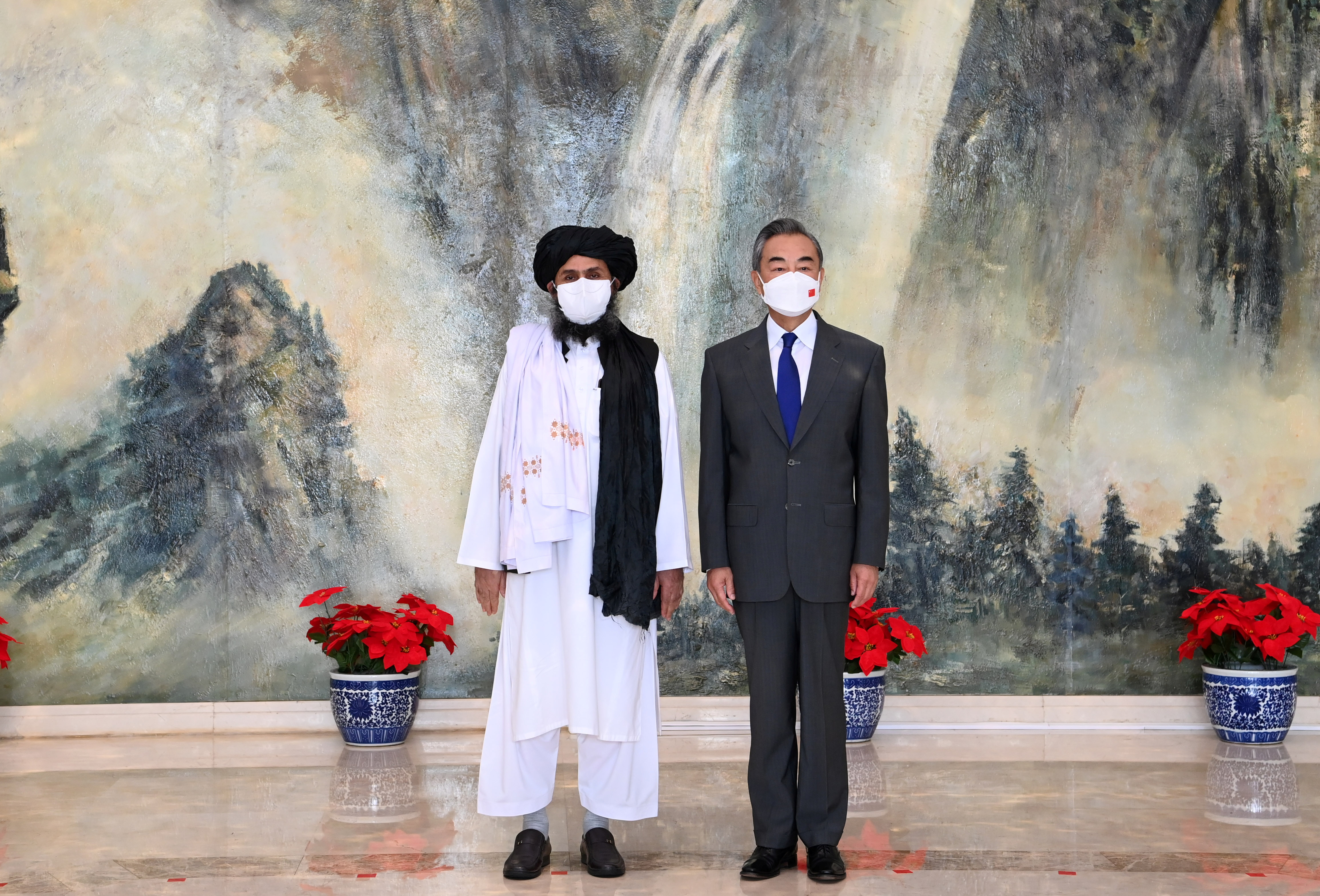 Chinese State Councilor and Foreign Minister Wang Yi meets with Mullah Abdul Ghani Baradar, political chief of Afghanistan's Taliban, in Tianjin, China July 28, 2021.  Li Ran/Xinhua via REUTERS