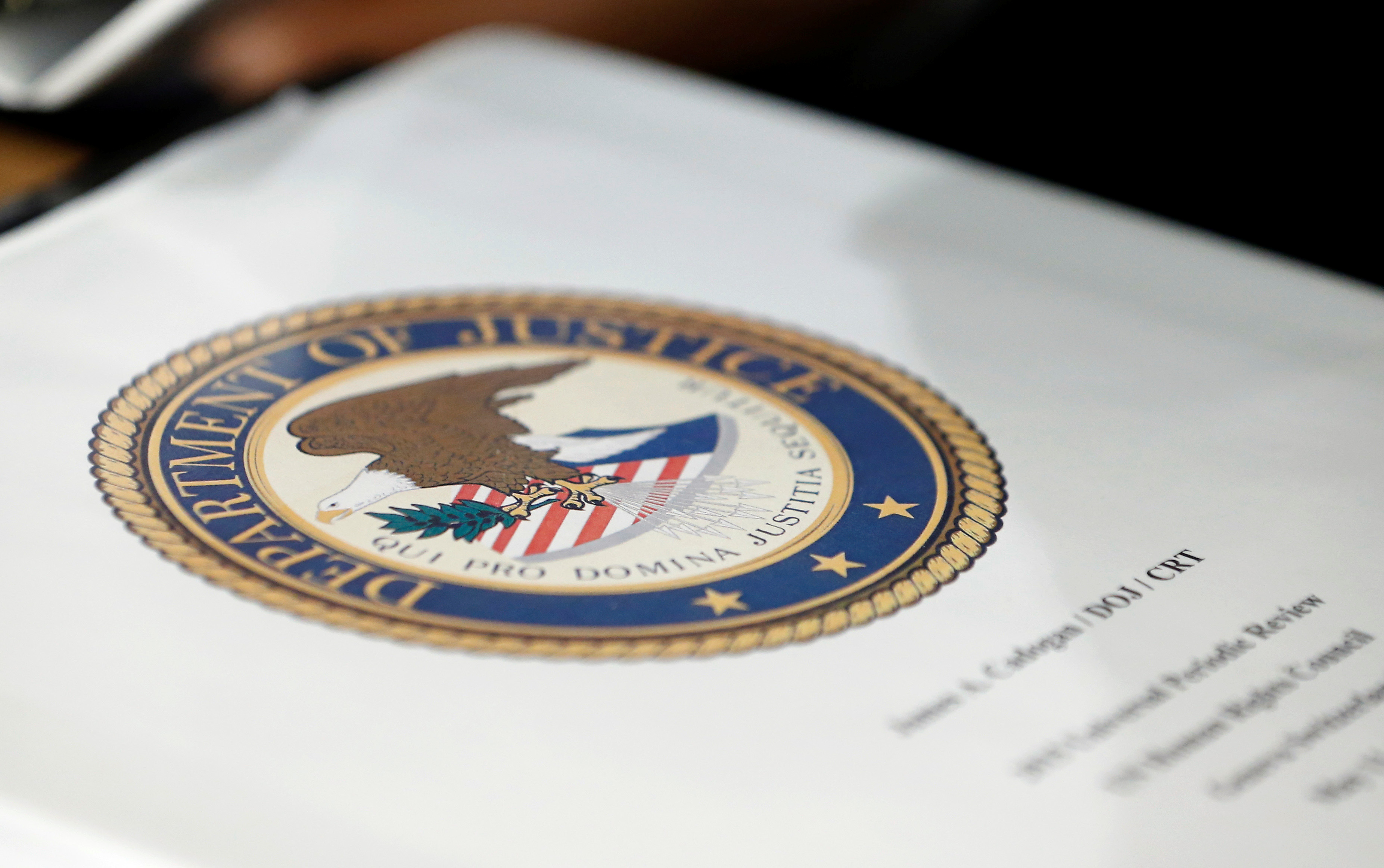 A folder with the seal of the U.S. Department of Justice sits on a table at the United Nations European headquarters in Geneva, Switzerland, May 11, 2015.   REUTERS/Denis Balibouse/File Photo