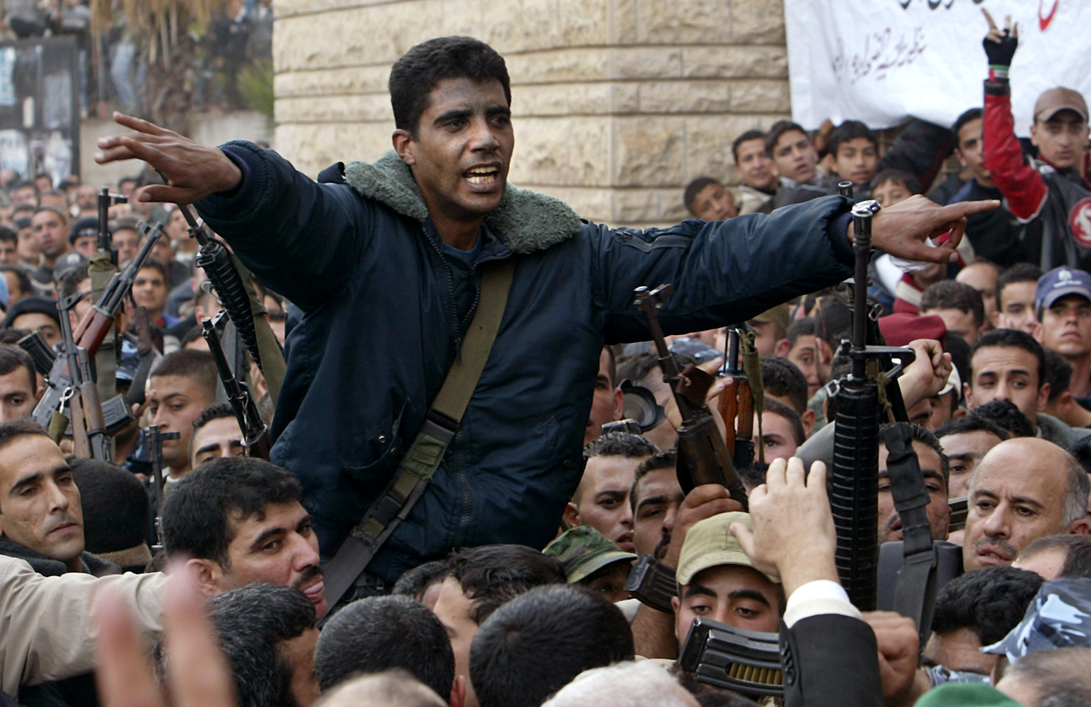 Palestinian commander of the militant Al Aqsa Martyrs Brigades Zakaria Zubeid is carried on the shoulders of supporters in Jenin, in the Israeli-occupied West Bank December 30, 2004.  REUTERS/Ammar Awad