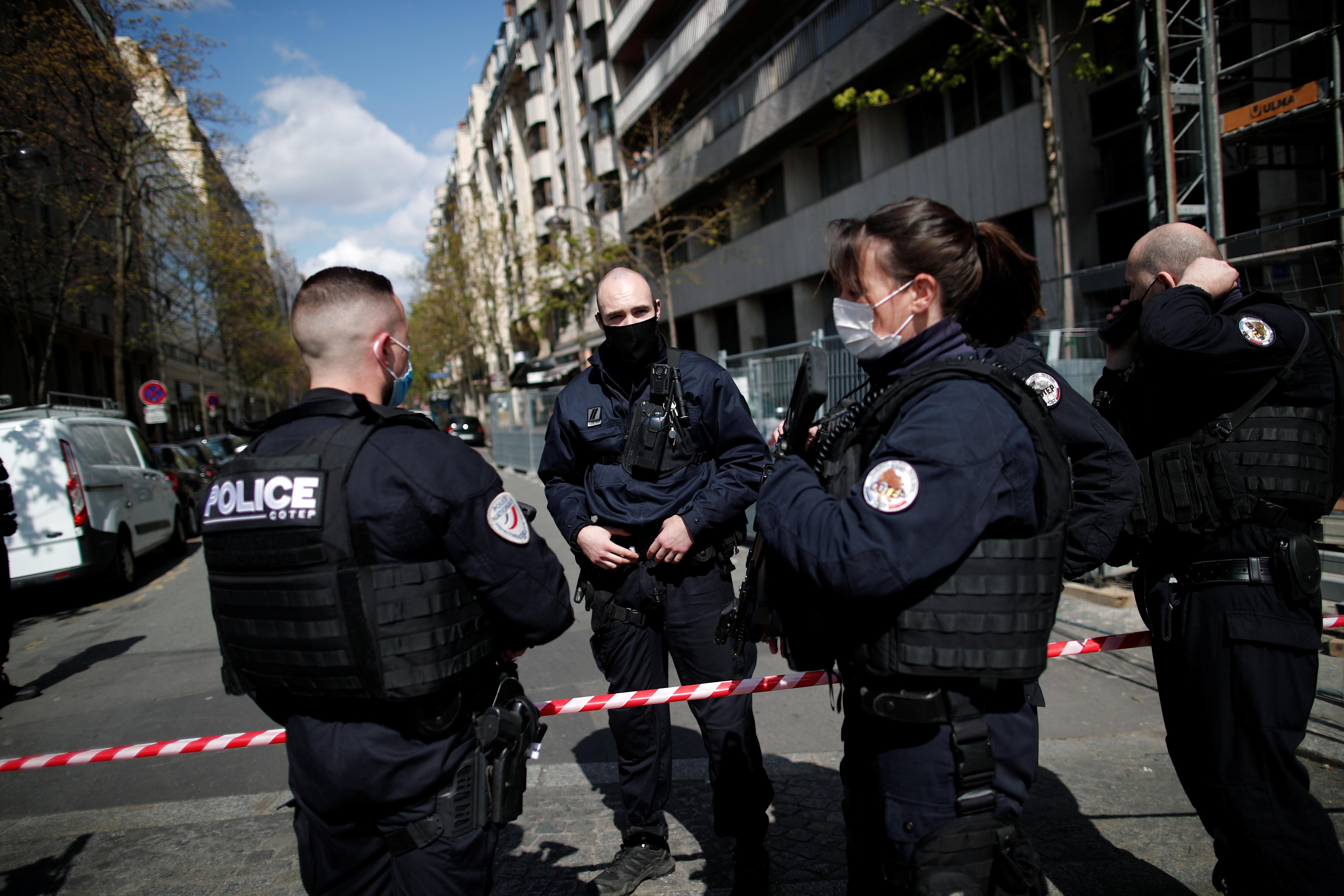 French police secure the area after one person was shot dead and one injured in front of the Henry Dunant hospital in Paris, France, April 12, 2021. REUTERS/Benoit Tessier
