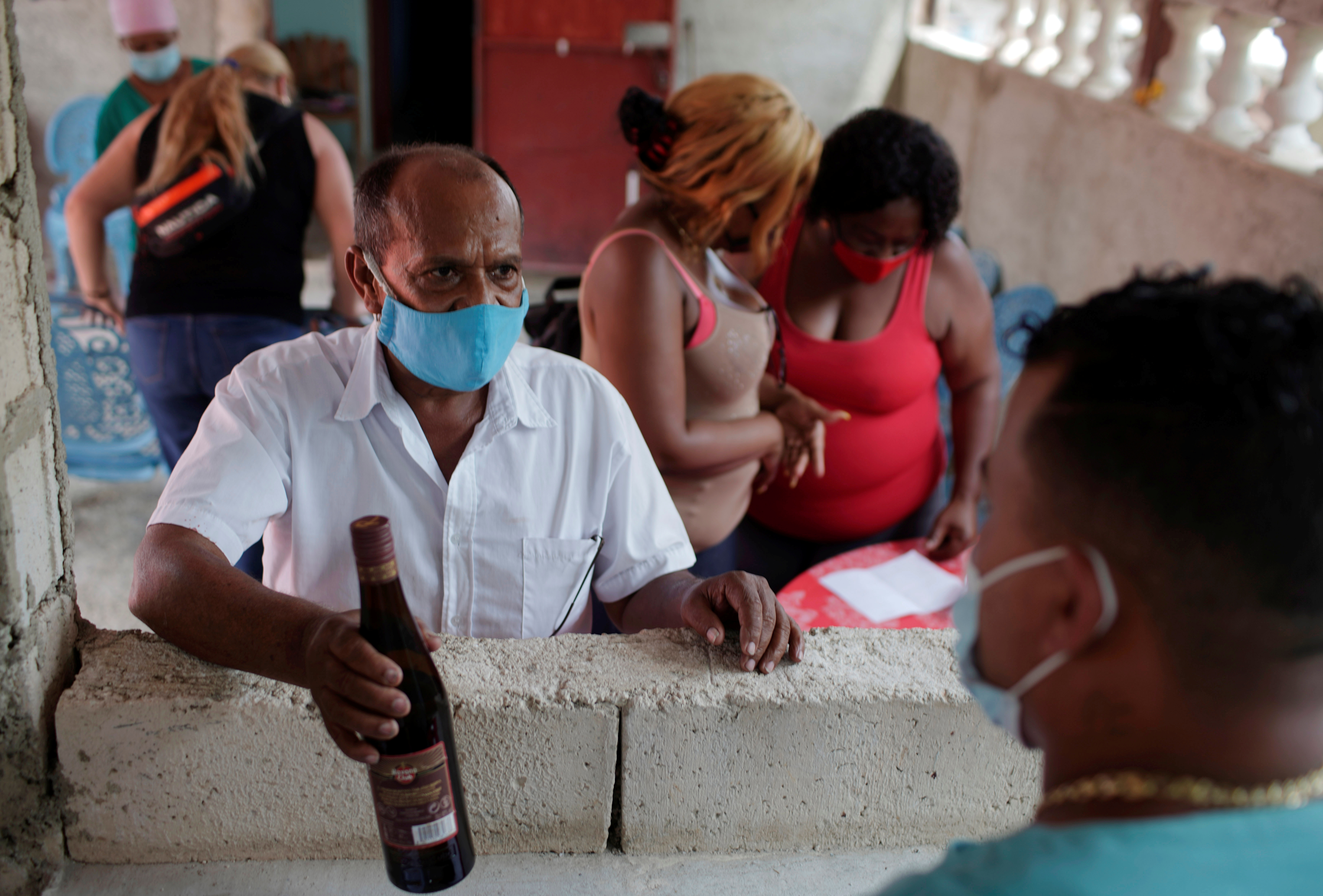 Chofer Eliasez Mendez buys herbal medicine in Havana, Cuba, April 9, 2021. Picture taken on April 9, 2021. REUTERS/Alexandre Meneghini