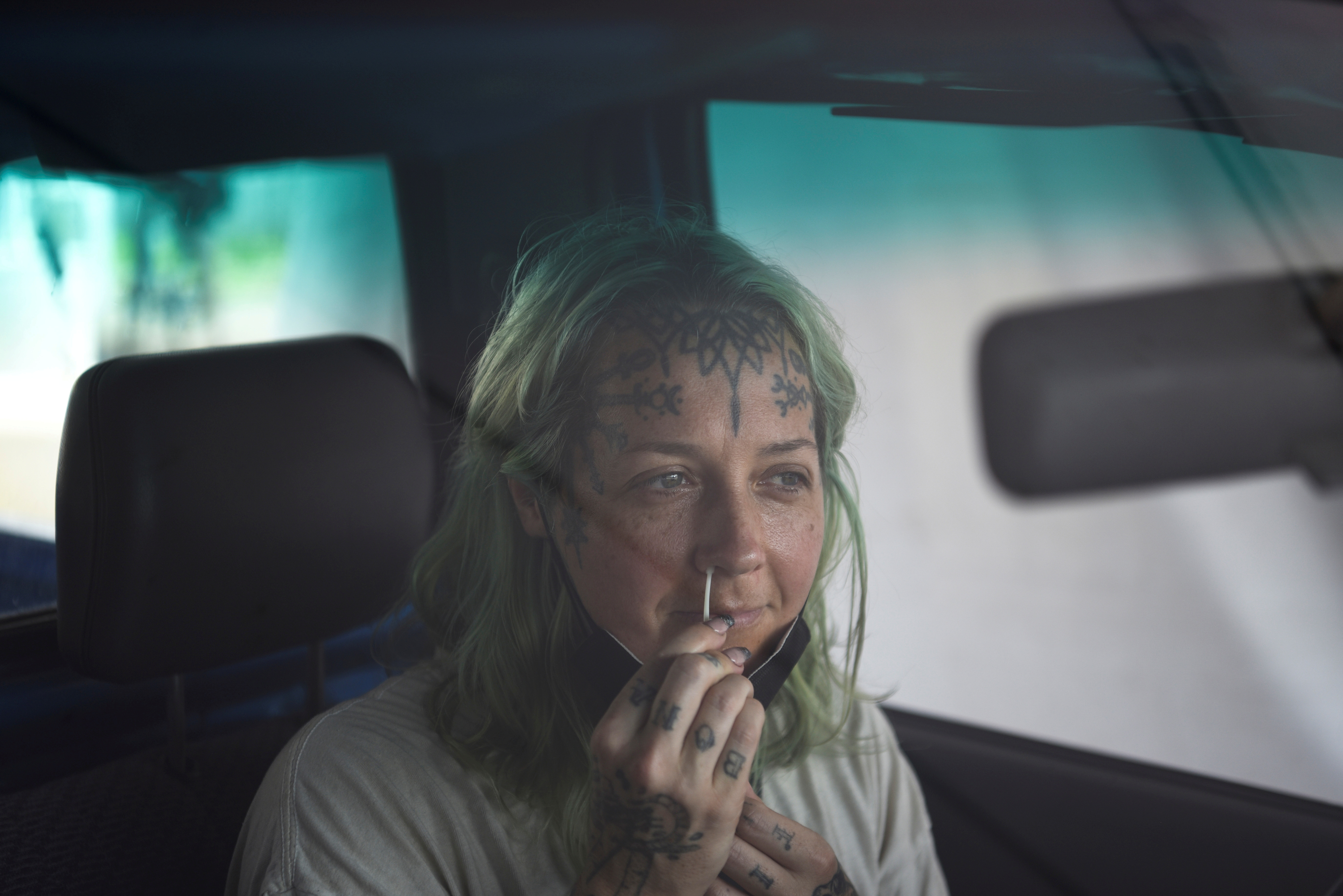 A person uses a nasal swab to provide a sample to be tested for the coronavirus disease (COVID-19) as cases surge across the state, in New Orleans, Louisiana, U.S., August 4, 2021. REUTERS/Callaghan O'Hare/File Photo