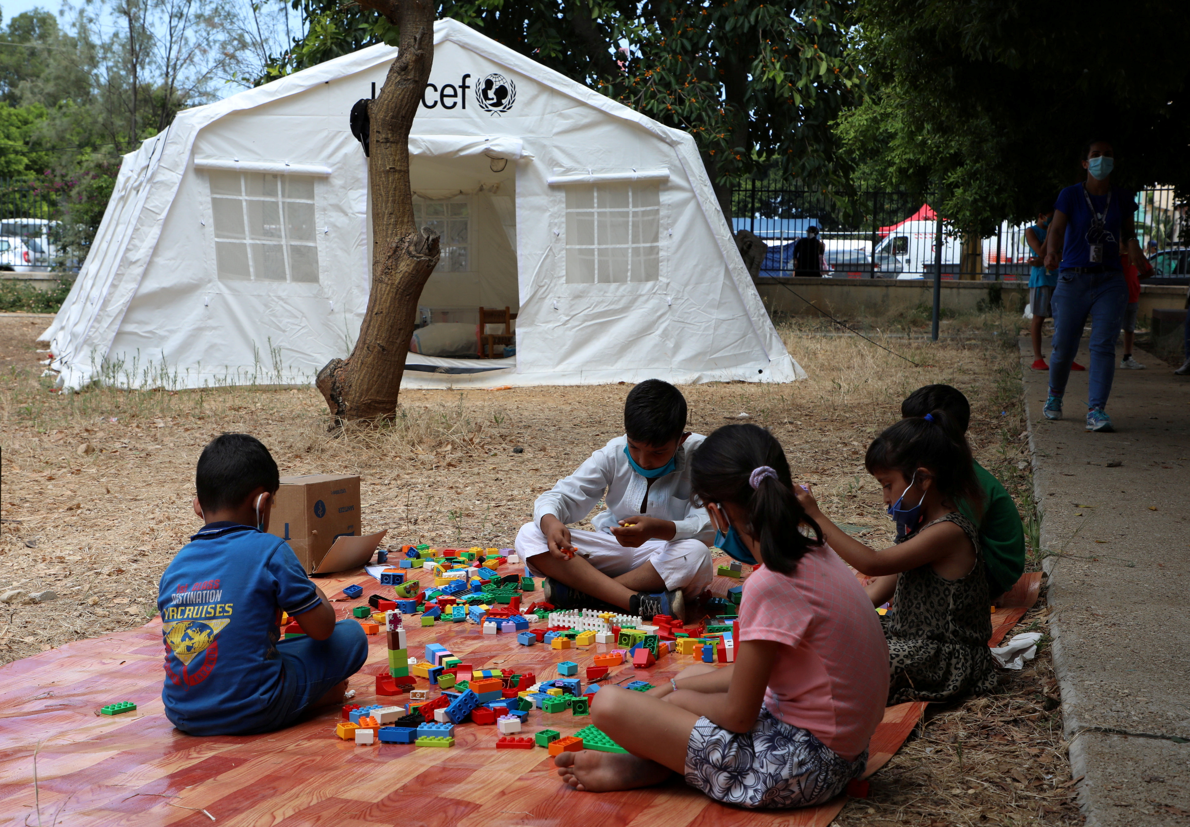 Children play outisde a UNICEF tent put in place to provide psychosocial support to people affected by a massive explosion in Beirut's port area, Lebanon August 20, 2020. Picture taken August 20, 2020. REUTERS/Mohamed Azakir/File Photo