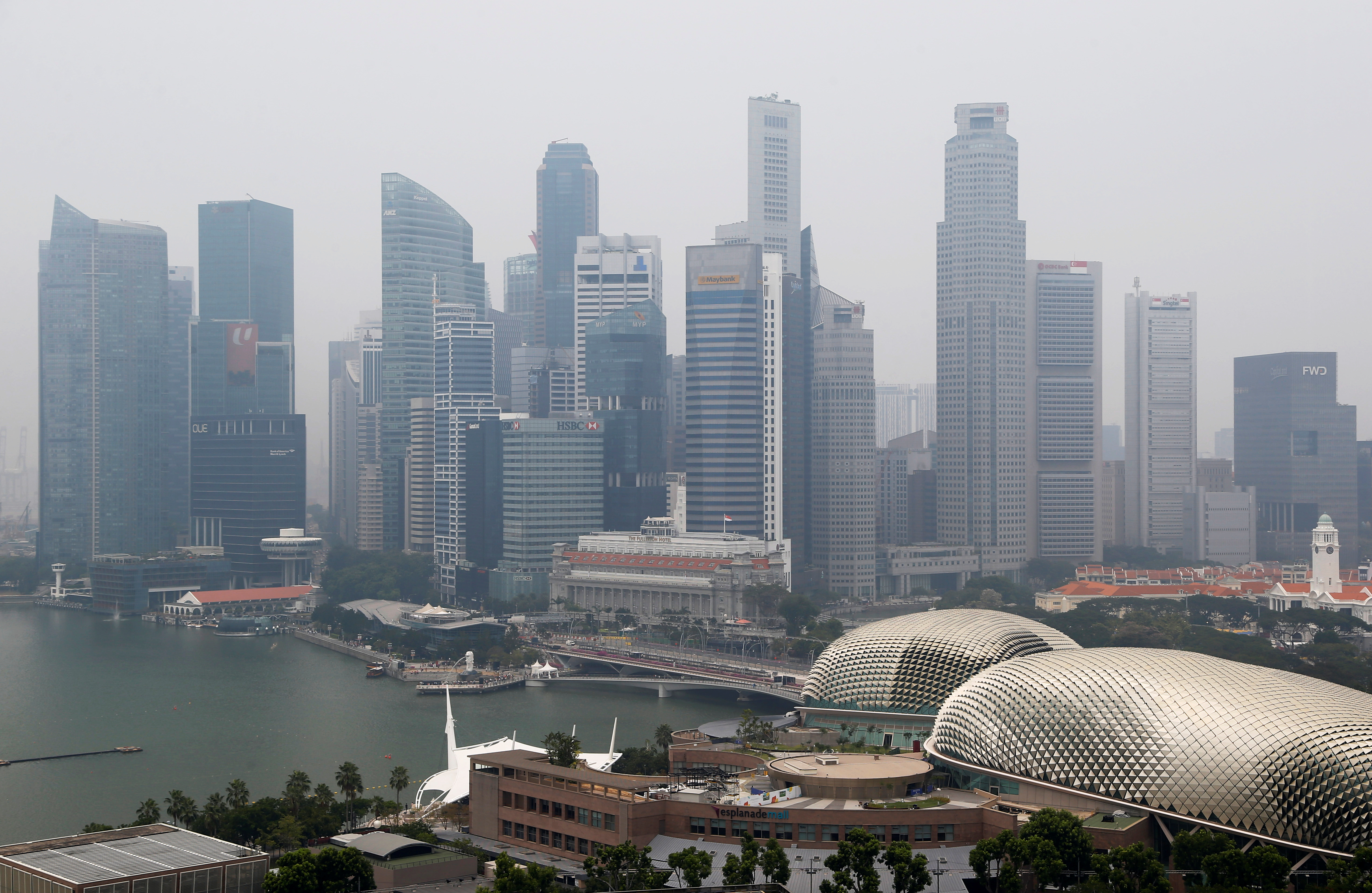 The financial district is seen shrouded by haze in Singapore September 18, 2019. REUTERS/Feline Lim