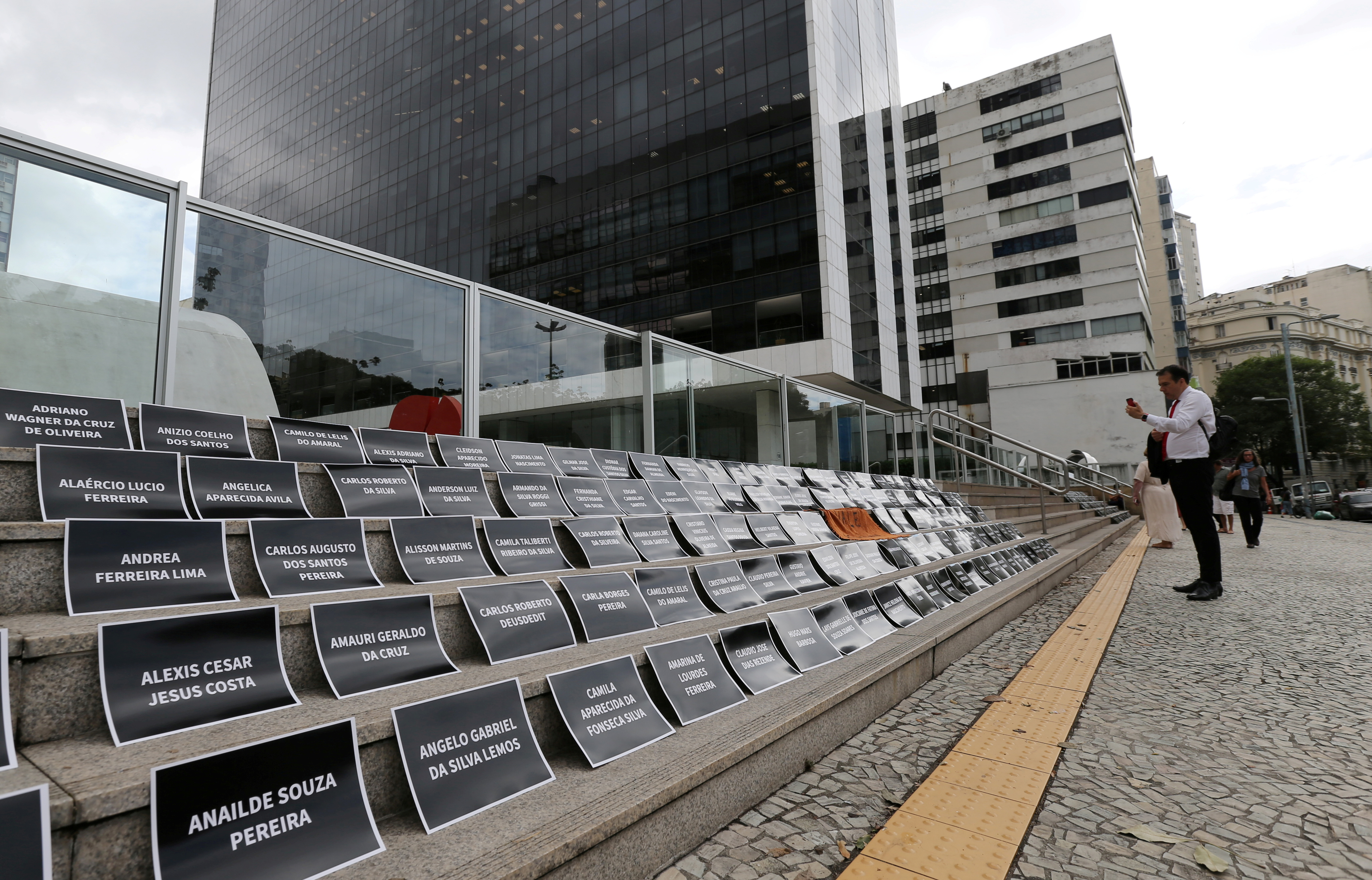 Placards with names of victims of a collapsed tailings dam owned by Vale SA are placed in front of the Brazilian mining company Vale SA buldiing, during an assembly of shareholders, in Rio de Janeiro, Brazil April 30, 2019. The banners reads