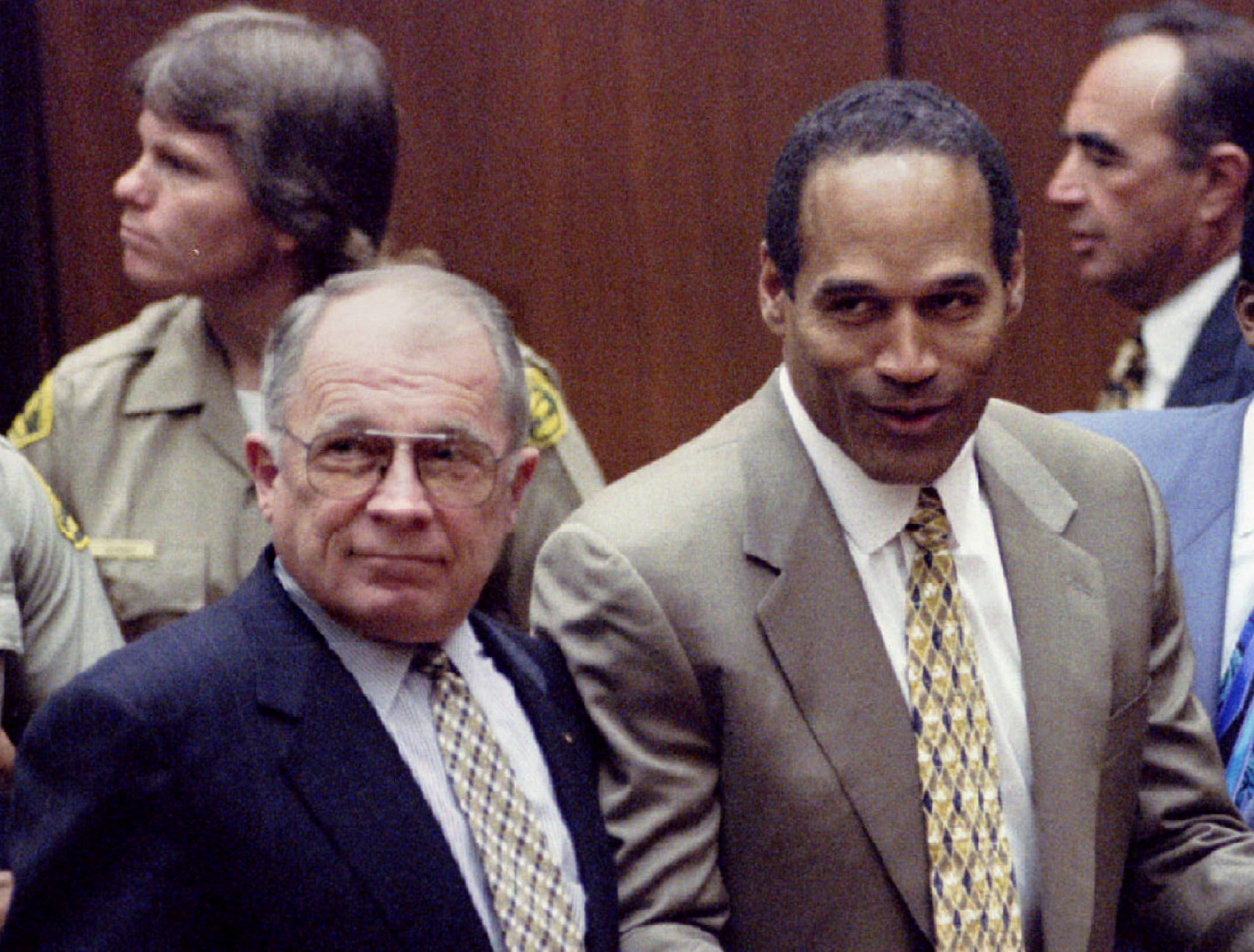 Defendant OJ Simpson reacts next to F. Lee Bailey after the court clerk announces that Simpson was found not guilty of  the murders of Nicole Simpson and Ronald Goldman, October 3, 1995. Pool via REUTERS/File Photo