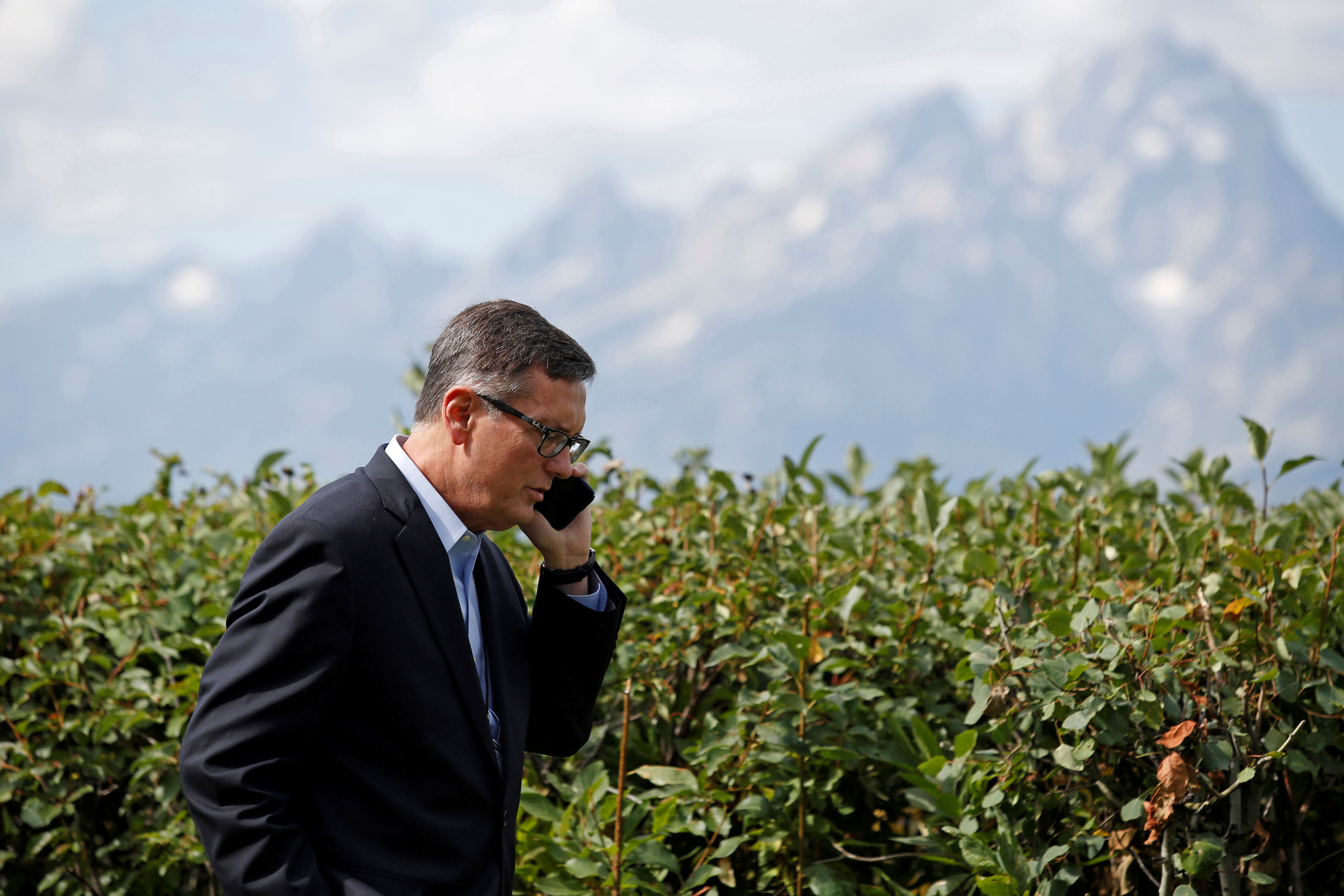 Federal Reserve Vice Chair Richard Clarida talks on the phone during the three-day