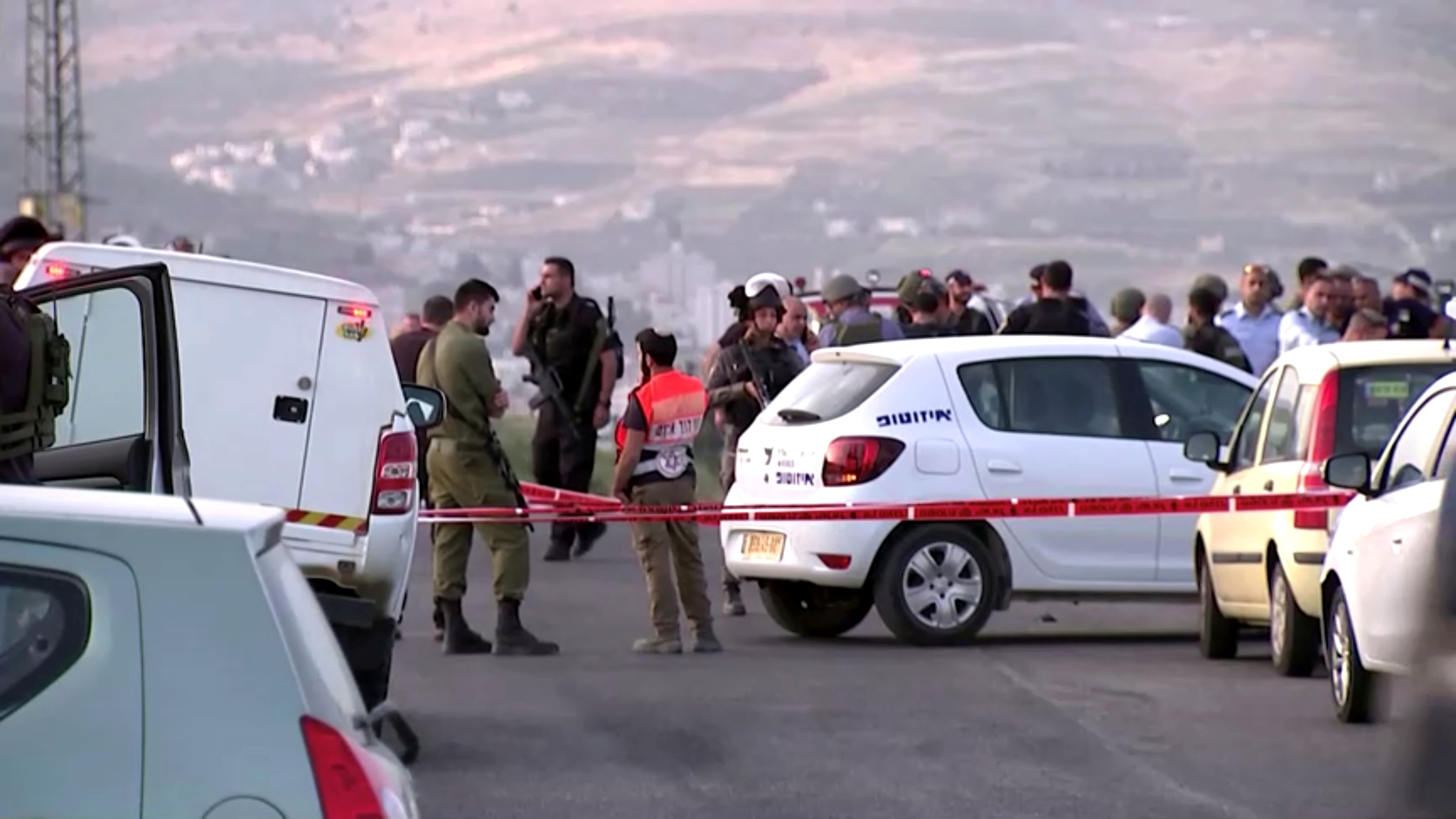 Members of Israeli forces gather at the scene of a shooting incident in the Israeli-occupied West Bank May 2, 2021, in this still image taken from a video. REUTERS/REUTERS TV/
