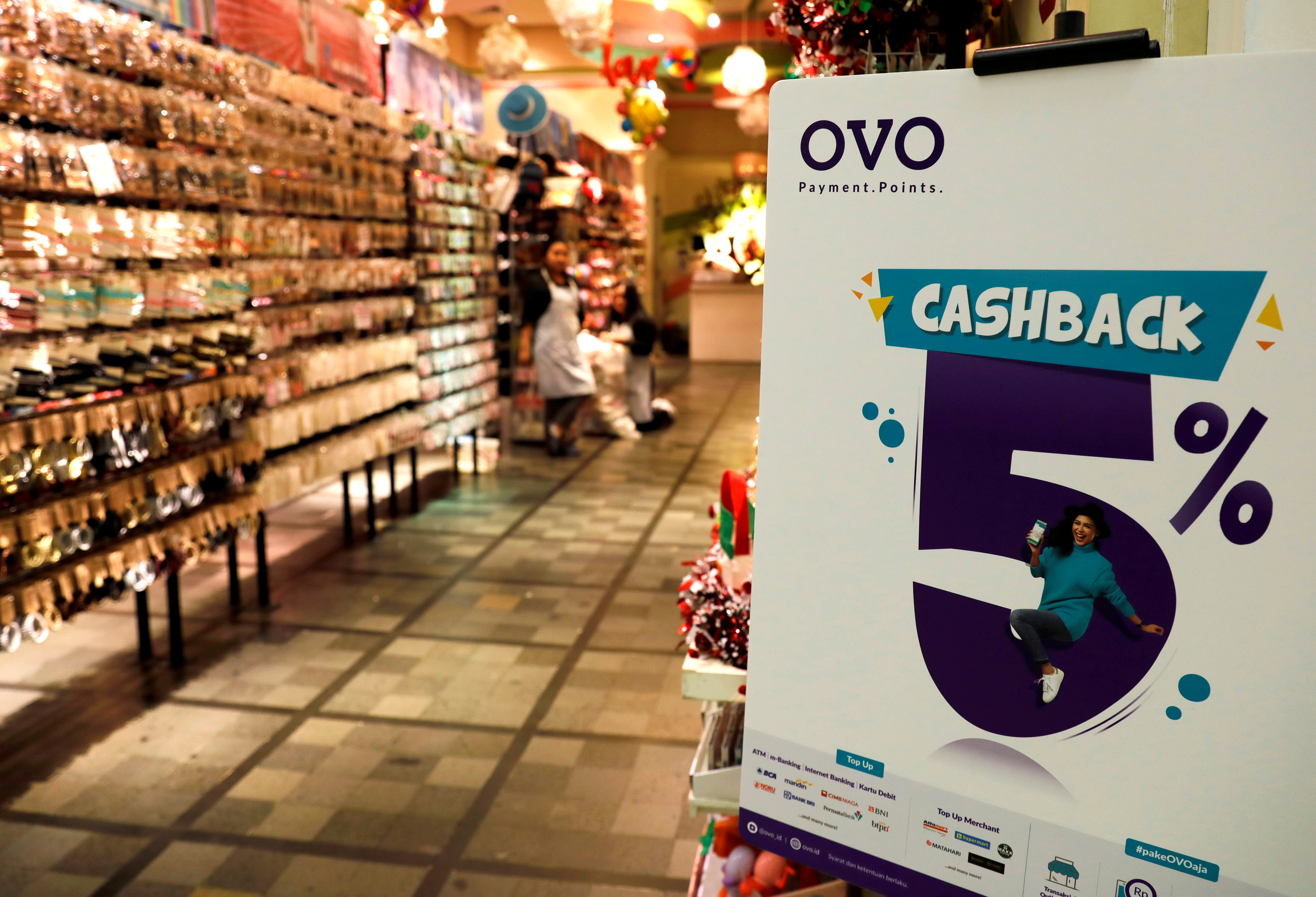 A sign of OVO payment is seen at a mall in Jakarta, Indonesia, November 8, 2018. Picture taken November 8, 2018. REUTERS/Beawiharta/File Photo