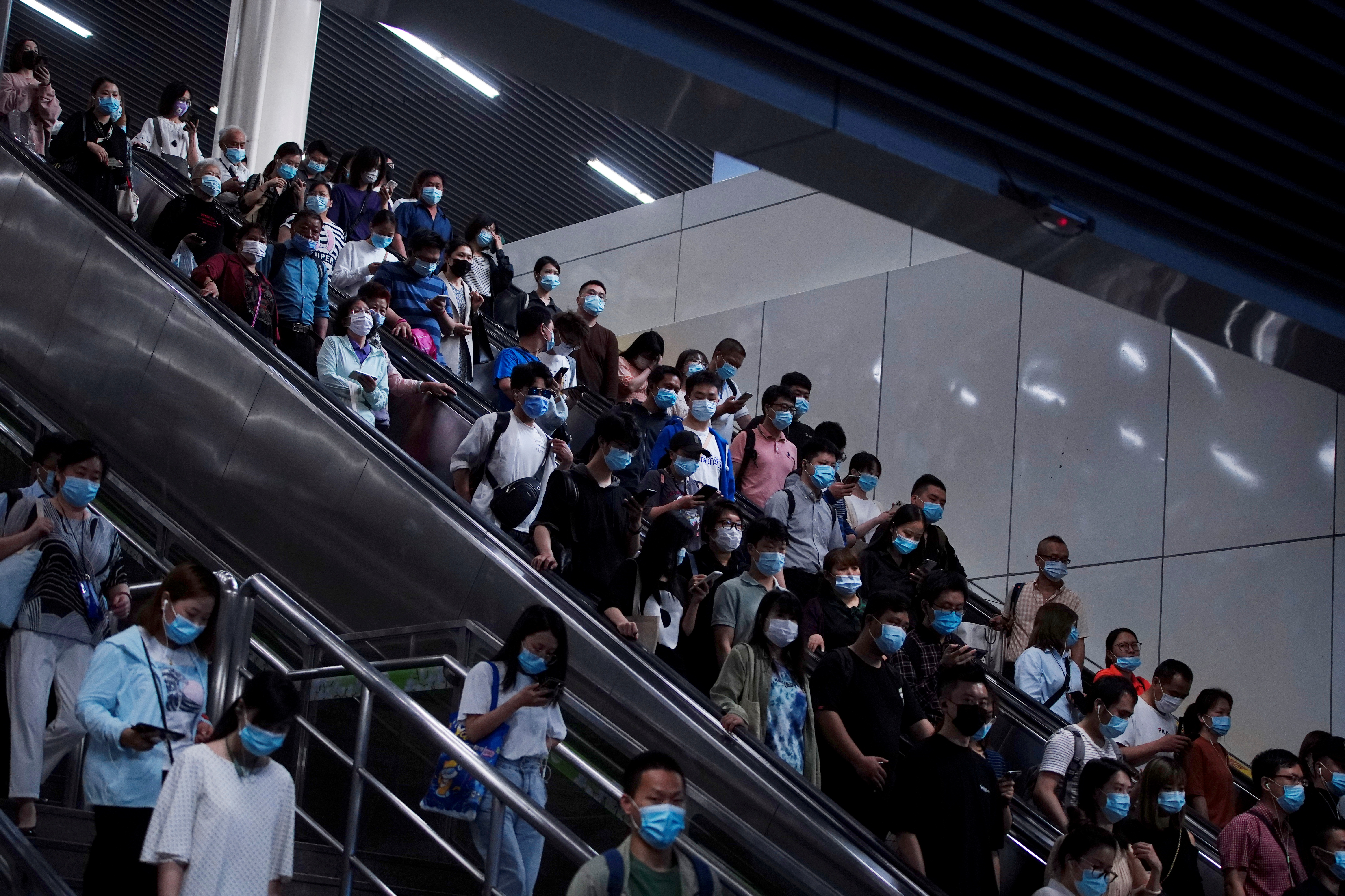 People walk at a subway station, following the outbreak of the coronavirus disease (COVID-19), in Shanghai, China May 11, 2021. REUTERS/Aly Song