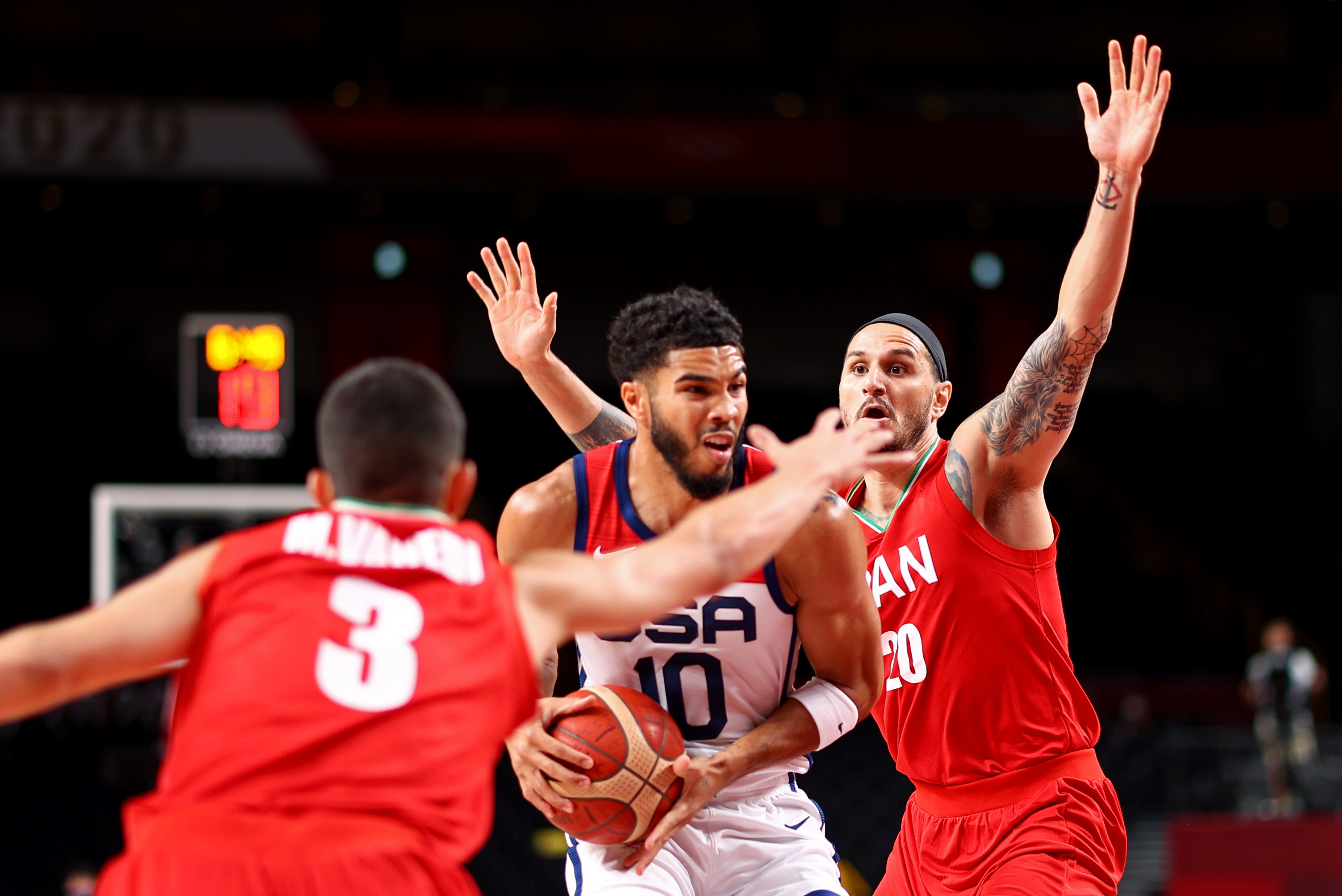 Tokyo 2020 Olympics - Basketball - Men - Group A - United States v Iran - Saitama Super Arena, Saitama, Japan - July 28, 2021. Jayson Tatum of the United States in action with Mike Rostampour of Iran REUTERS/Brian Snyder