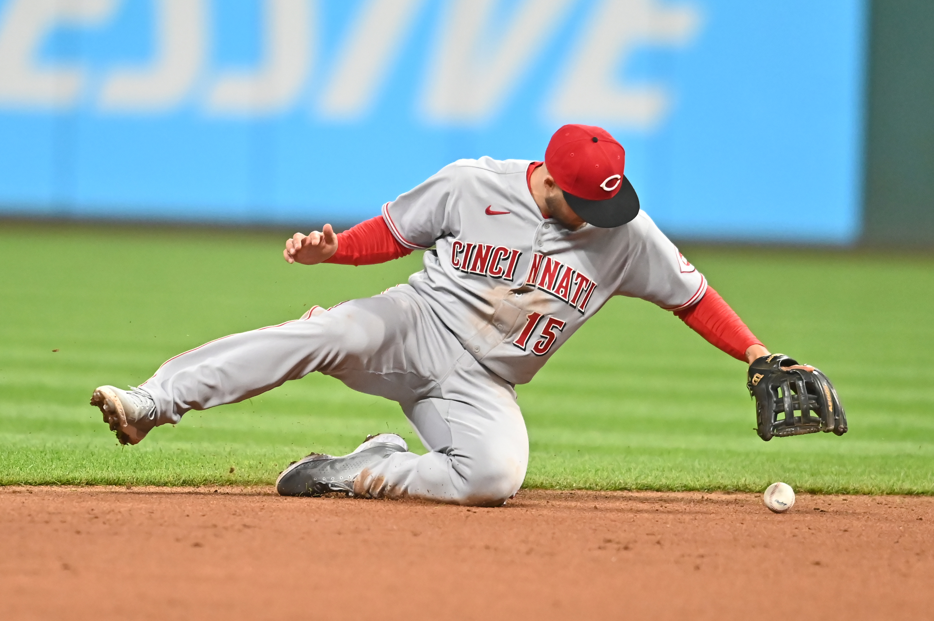 May 7, 2021; Cleveland, Ohio, USA; Cincinnati Reds second baseman Nick Senzel (15) commits a fielding error as he bobbles a ball hit by Cleveland Indians shortstop Amed Rosario (not pictured) during the sixth inning at Progressive Field. Mandatory Credit: Ken Blaze-USA TODAY Sports