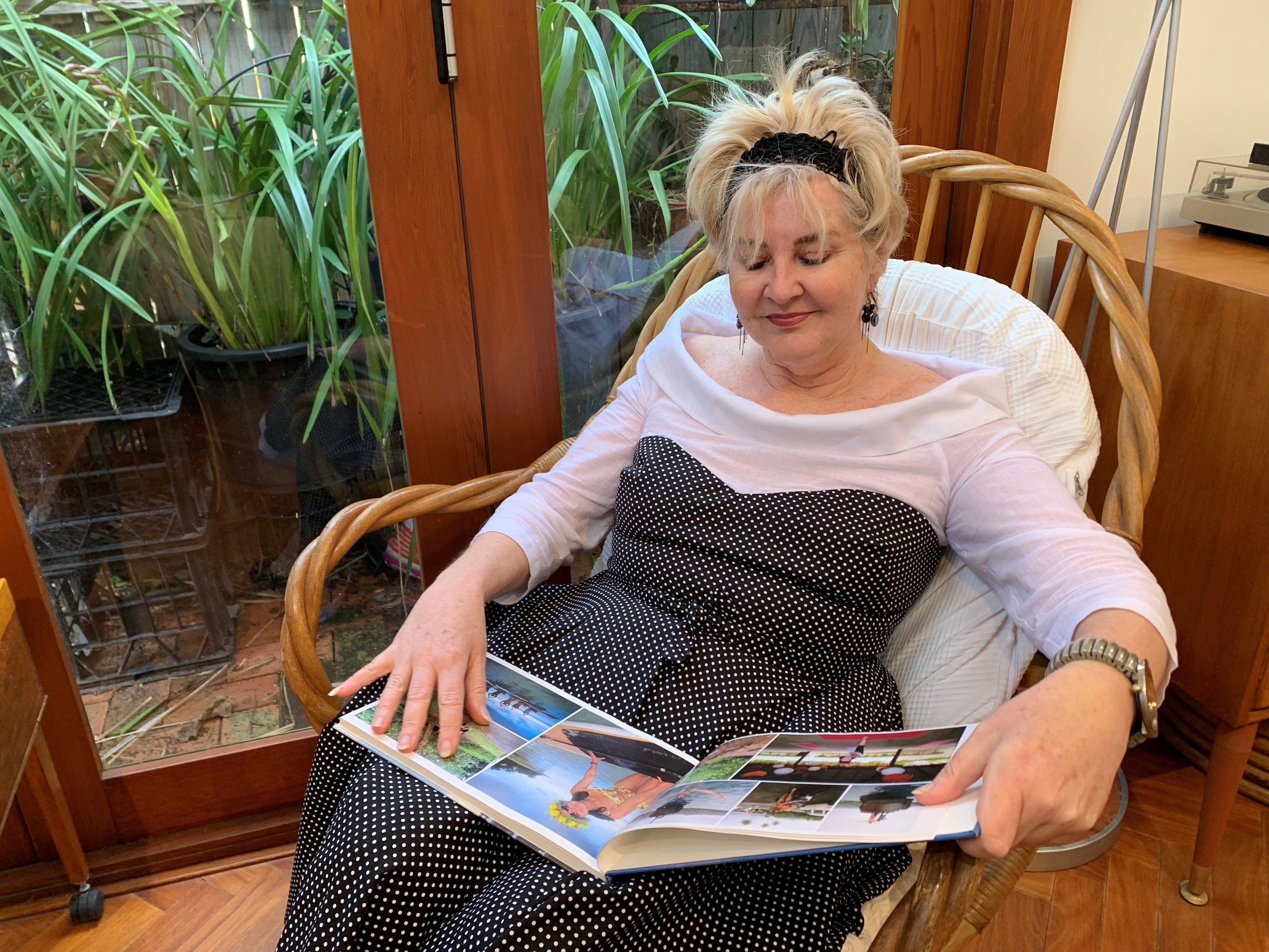 Retiree Nicole Miller looks through her cruise photo album as Australia's conservative approach to reopening and slow rollout of coronavirus disease (COVID-19) vaccinations has adversely affected the tourism industry, in Sydney, Australia, July 6, 2021. REUTERS/Stefica Nicol Bikes