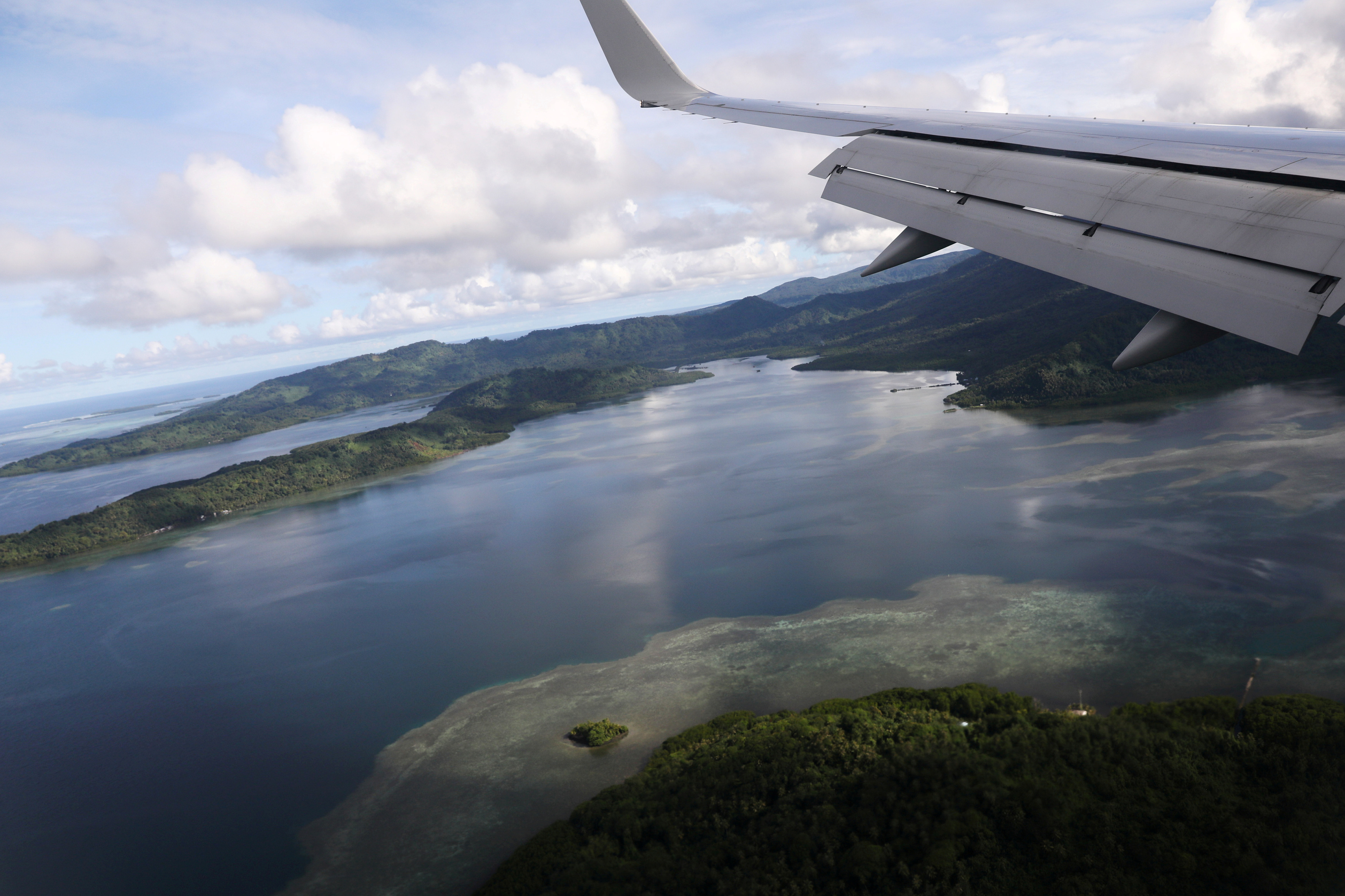 U.S. Secretary of State Mike Pompeo's plane makes a landing approach towards Pohnpei International Airport in Kolonia, Federated States of Micronesia, August 5, 2019. REUTERS/Jonathan Ernst/File Photo