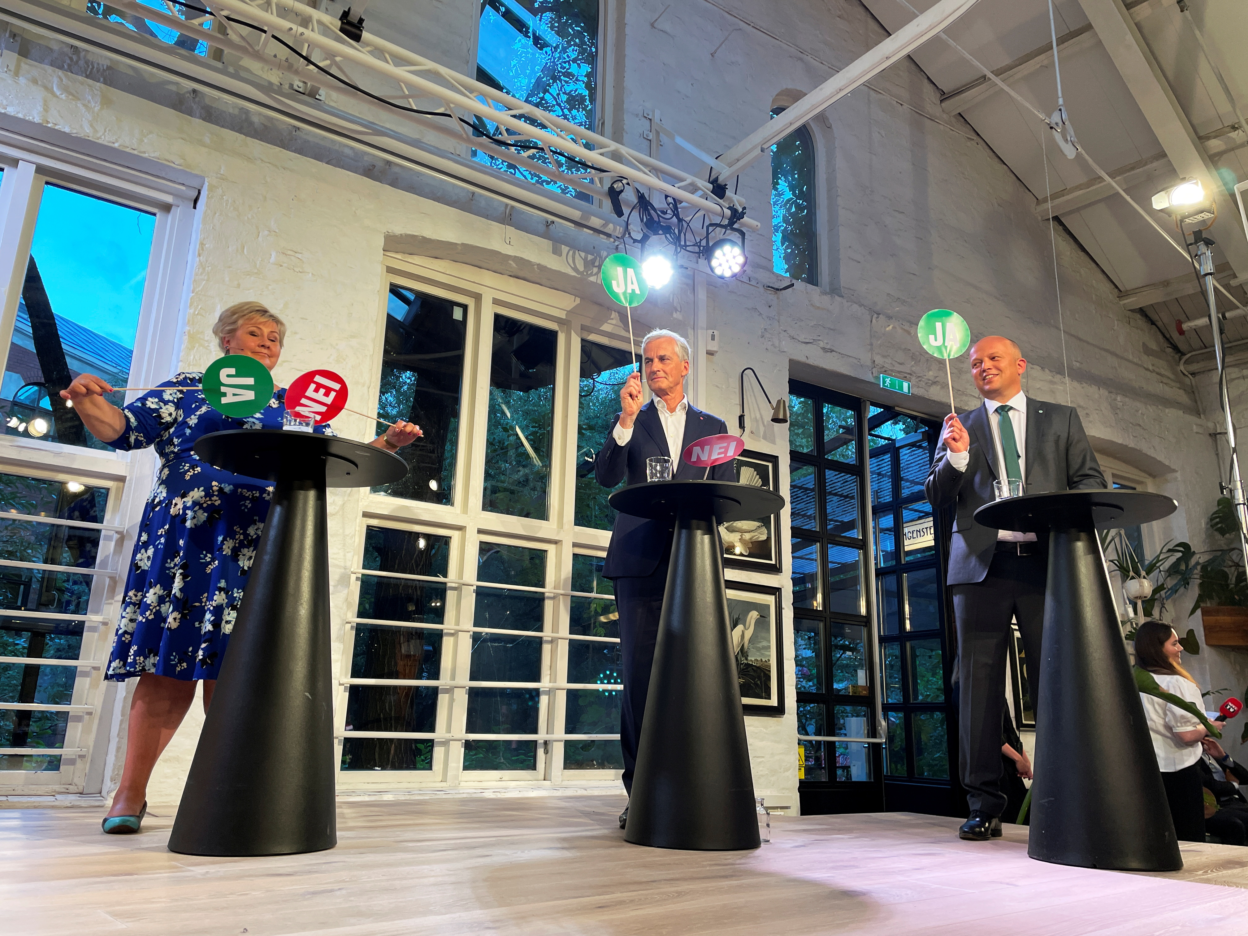 The three candidates for Norway's prime minister Erna Solberg from the Conservatives, Jonas Gahr Stoere from Labour Party and Trygve Slagsvold Vedum from the Centre Party attend a debate in central Oslo, Norway August 9, 2021. Picture taken August 9, 2021. REUTERS/Gwladys Fouche