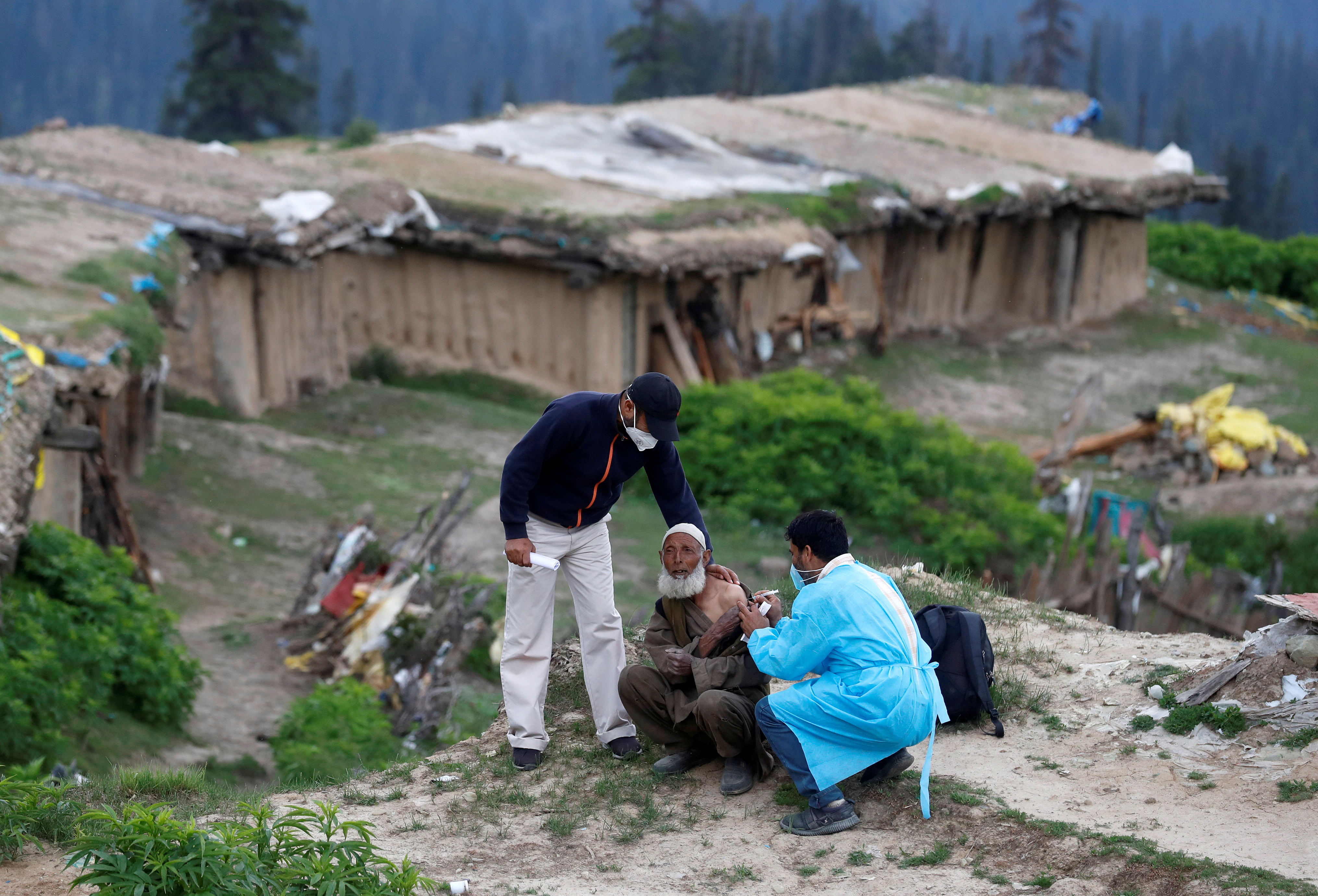 A shepherd man receives a dose of COVISHIELD, a coronavirus disease (COVID-19) vaccine manufactured by Serum Institute of India, during a vaccination drive at Tosa Maidan in central Kashmir's Budgam district June 21, 2021. REUTERS/Danish Ismail