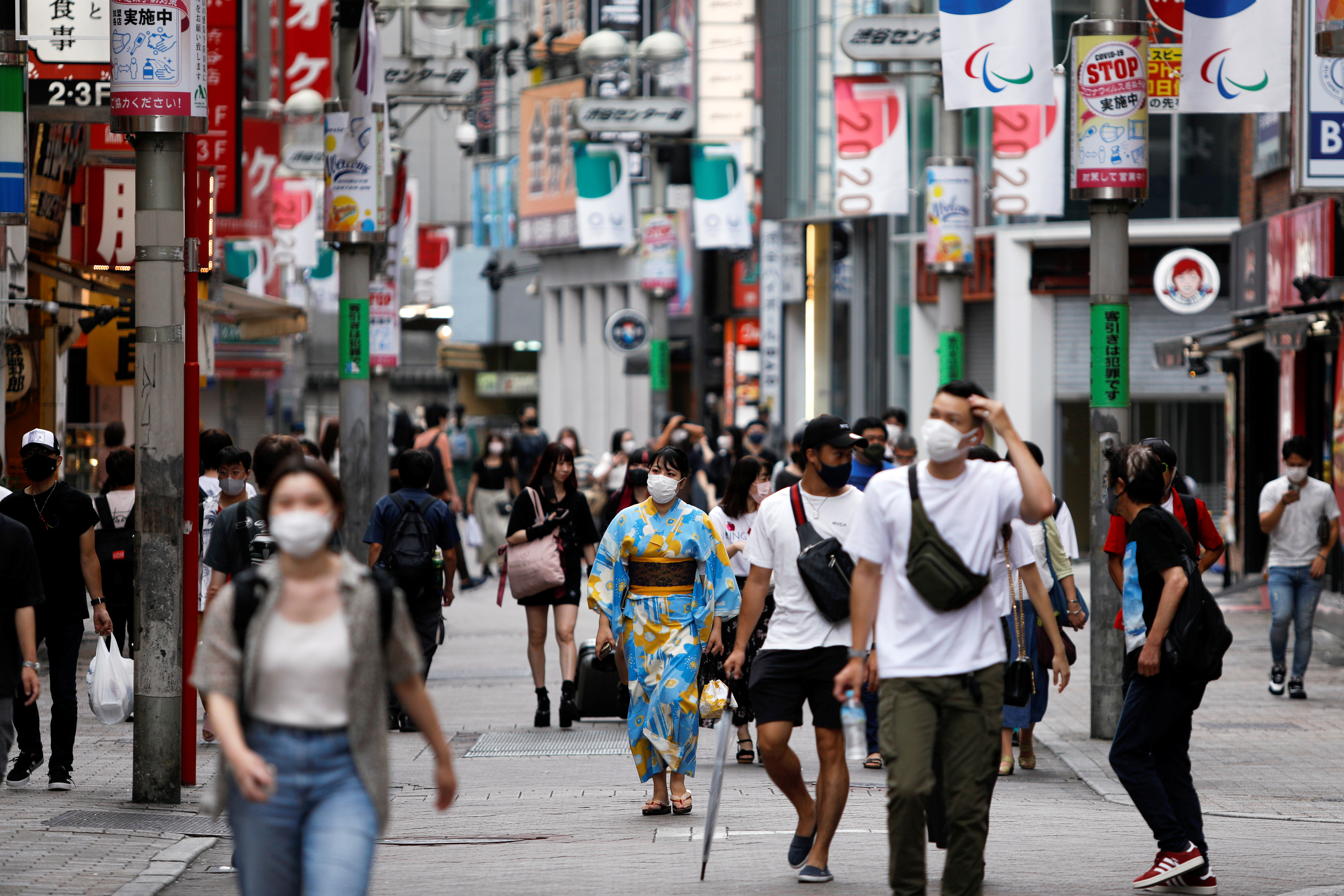 People walk in Shibuya shopping area, during a state of emergency amid the coronavirus disease (COVID-19) outbreak in Tokyo, Japan August 29, 2021. REUTERS/Androniki?Christodoulou