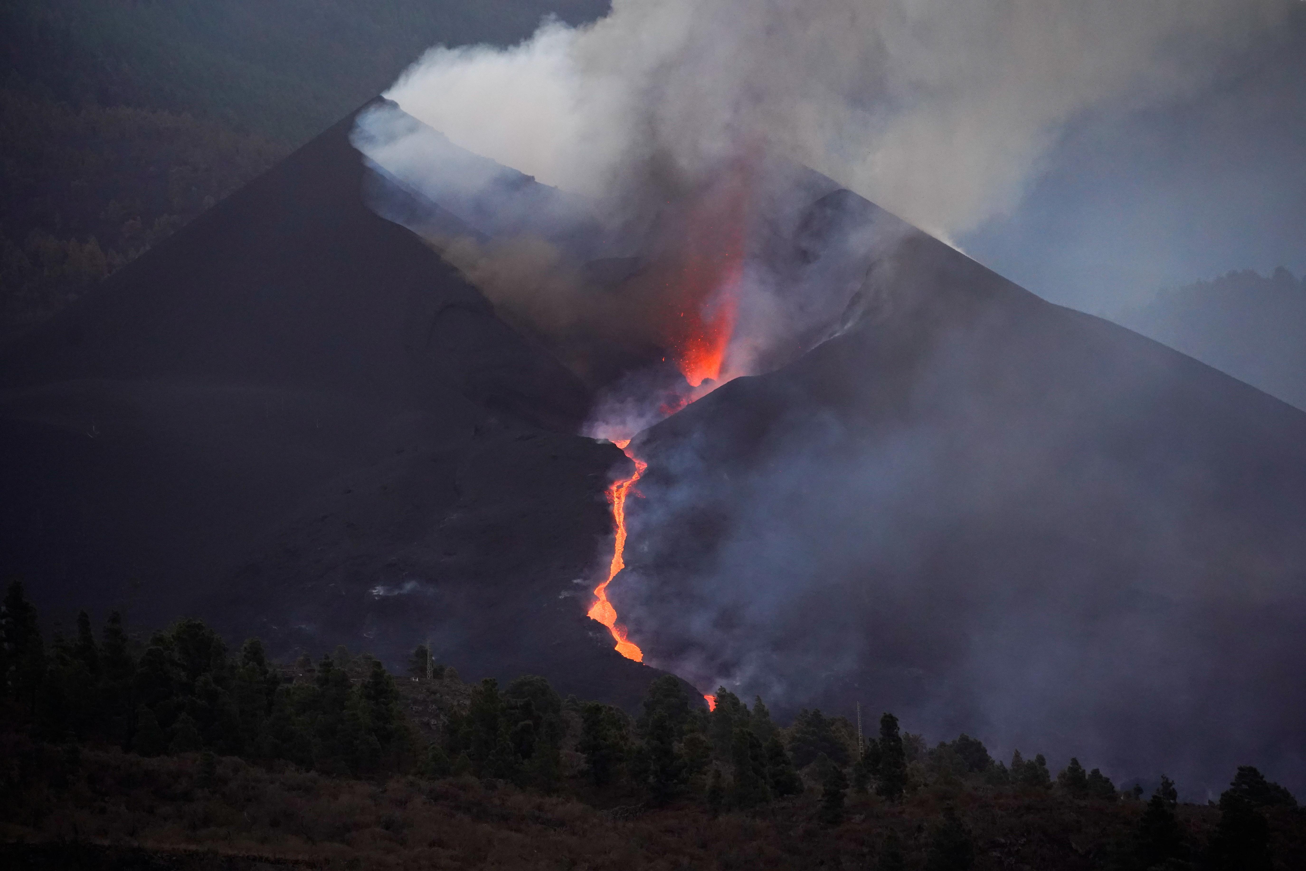 The Cumbre Vieja volcano continues to erupt on the Canary Island of La Palma, as seen from Tajuya, Spain, October 10, 2021. REUTERS/Juan Medina