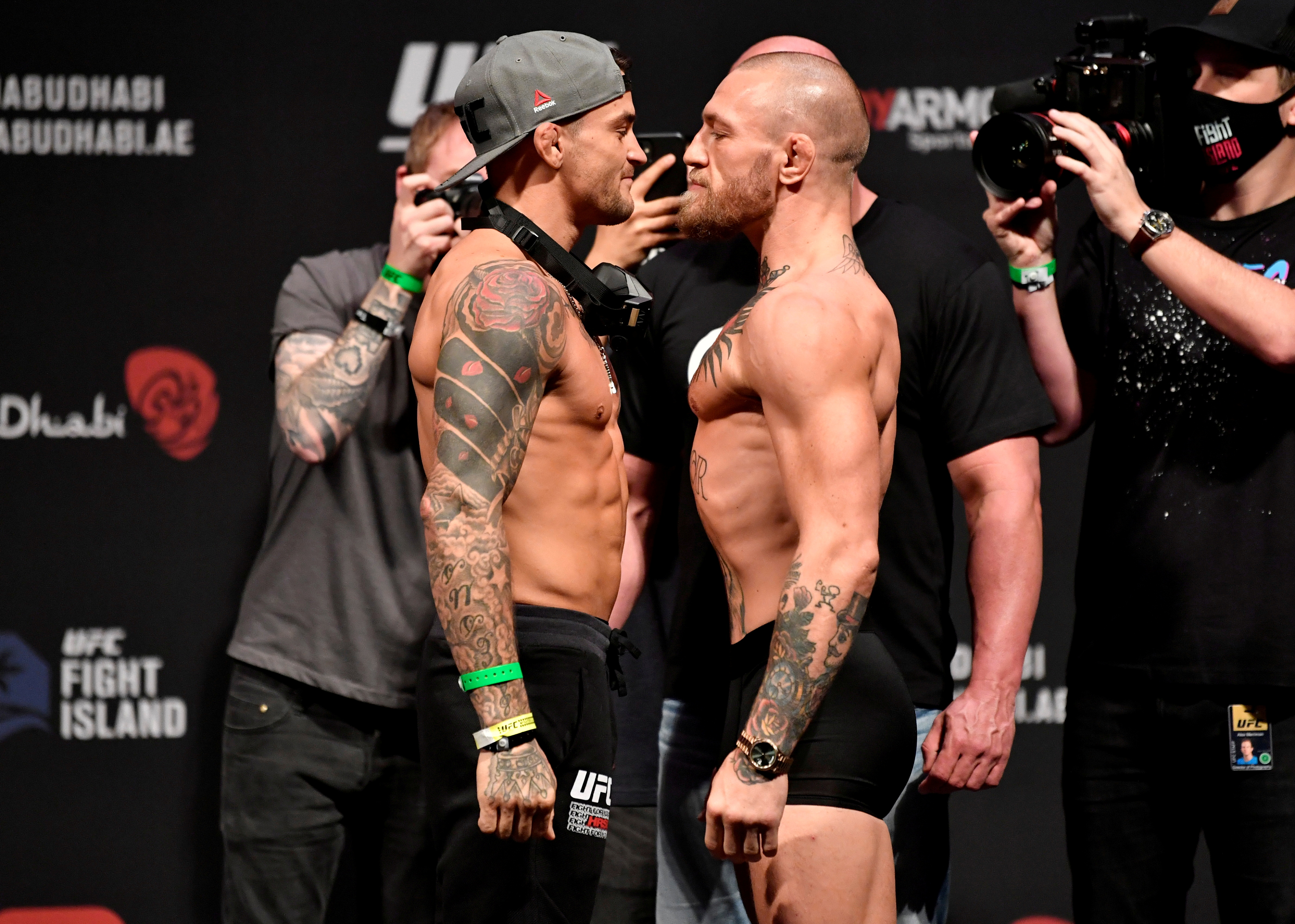 Jan 22, 2021; Abu Dhabi, UNITED ARAB EMIRATES;   Dustin Poirier and Conor McGregor of Ireland face off during the UFC 257 weigh-in at Etihad Arena on UFC Fight Island on January 22, 2021 in Abu Dhabi, United Arab Emirates. Mandatory Credit: Jeff Bottari/Handout Photo via USA TODAY Sports/File Photo