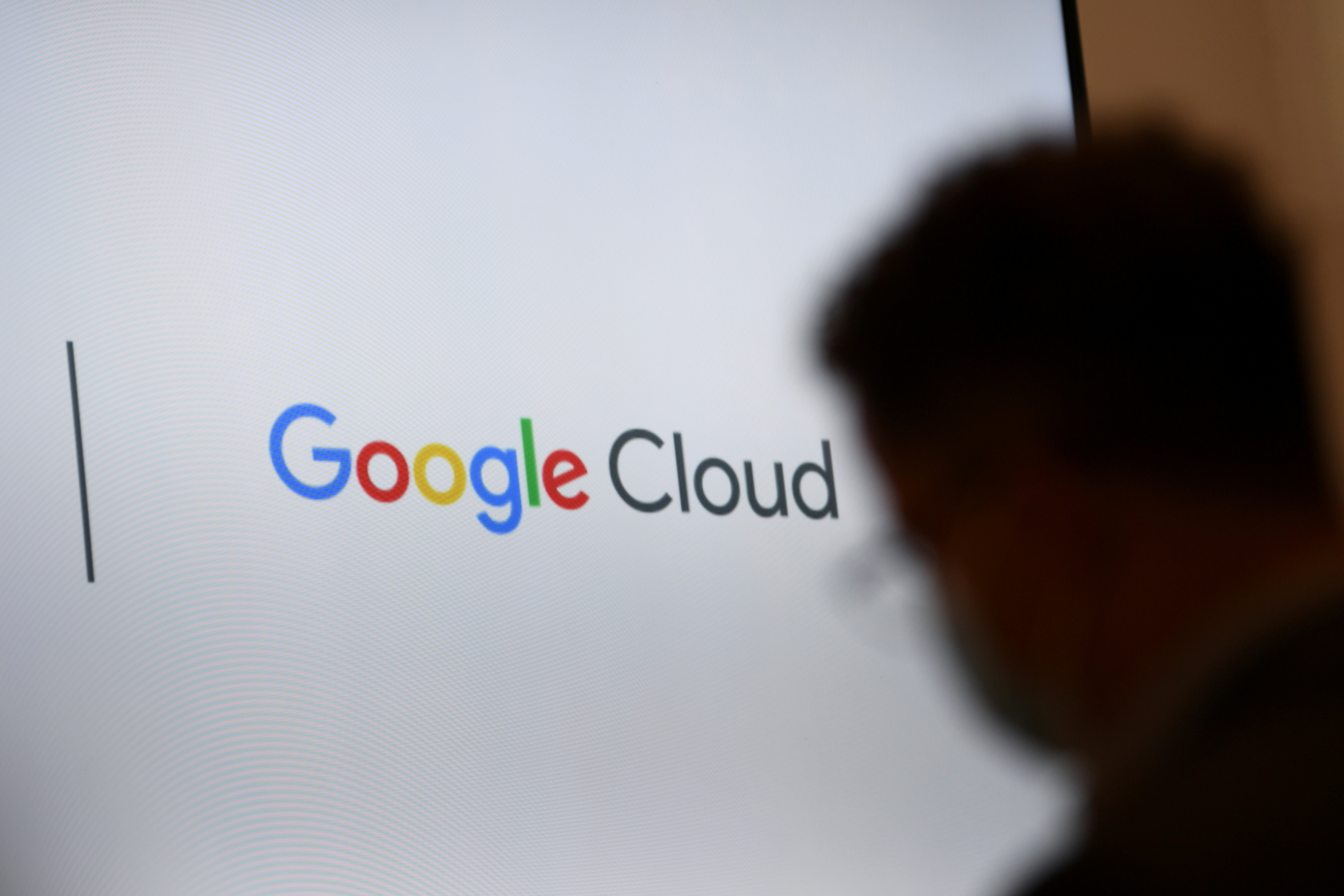 A screen with a Google Cloud logo is pictured during Google's presentation of a detailed investment plan for Germany outside the Google office in Berlin, Germany, August 31, 2021.  REUTERS/Annegret Hilse/File Photo